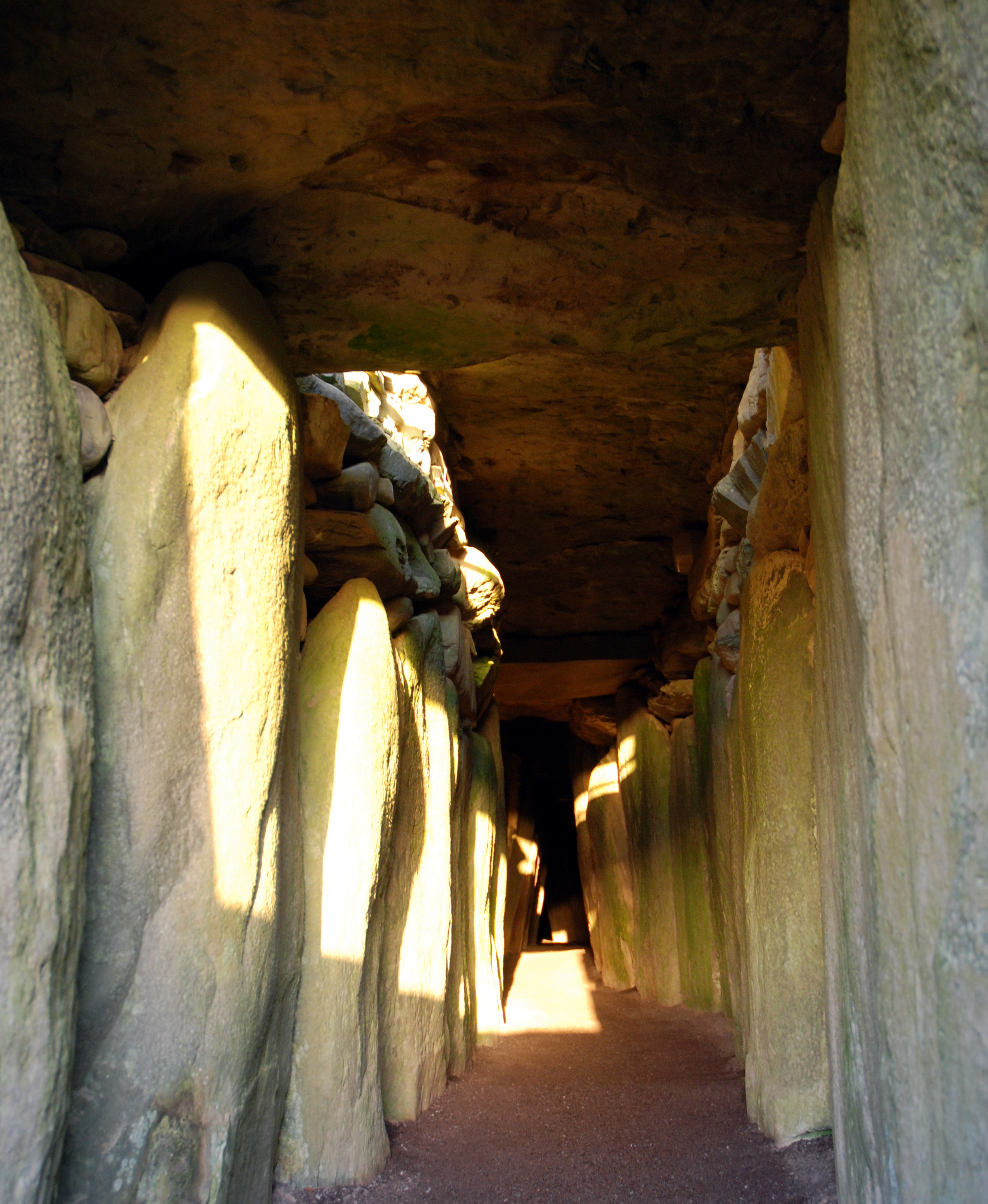 Winter Solstice light streams down the corridor to the light up the chamber far within Newgrange photo credit BoyneValleyTours.com