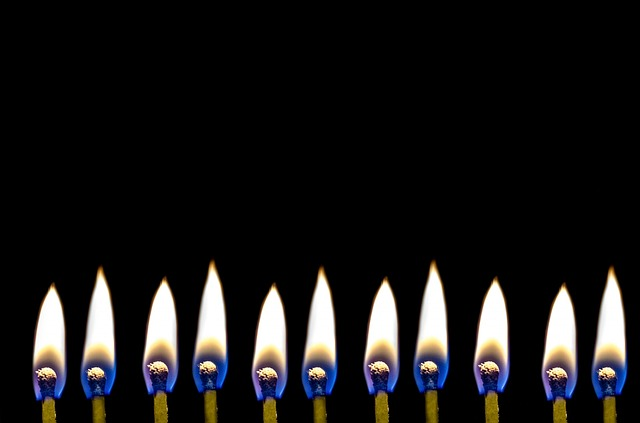 When the puritans made christmas illegal, the christians put candles in their windows to signal priests that it was safe to come to their homes to celebrate the holy days