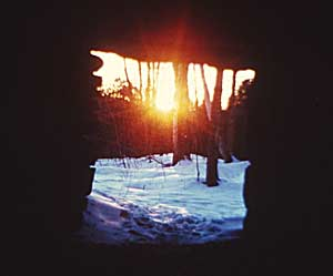 Winter Solstice Sun rising through a notch in the terrain, as seen from the central chamber of Calender 11 Photo by Byron Cox
