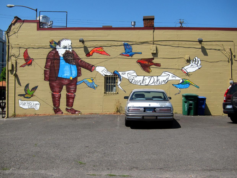 The Tale of Frank Dekum. Dekum and MLK. Spray paint. 18' x 35'. 2012