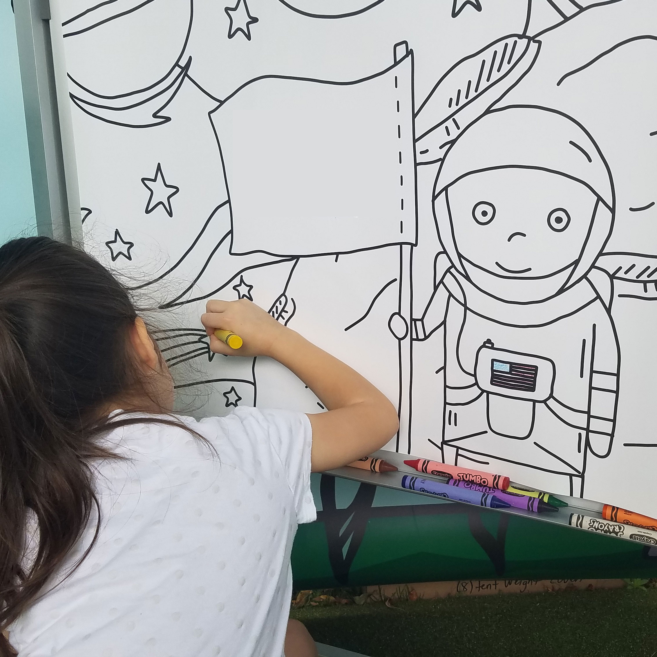 At the U.Fund Dreams Tour mural, Violet went right for the astronaut.