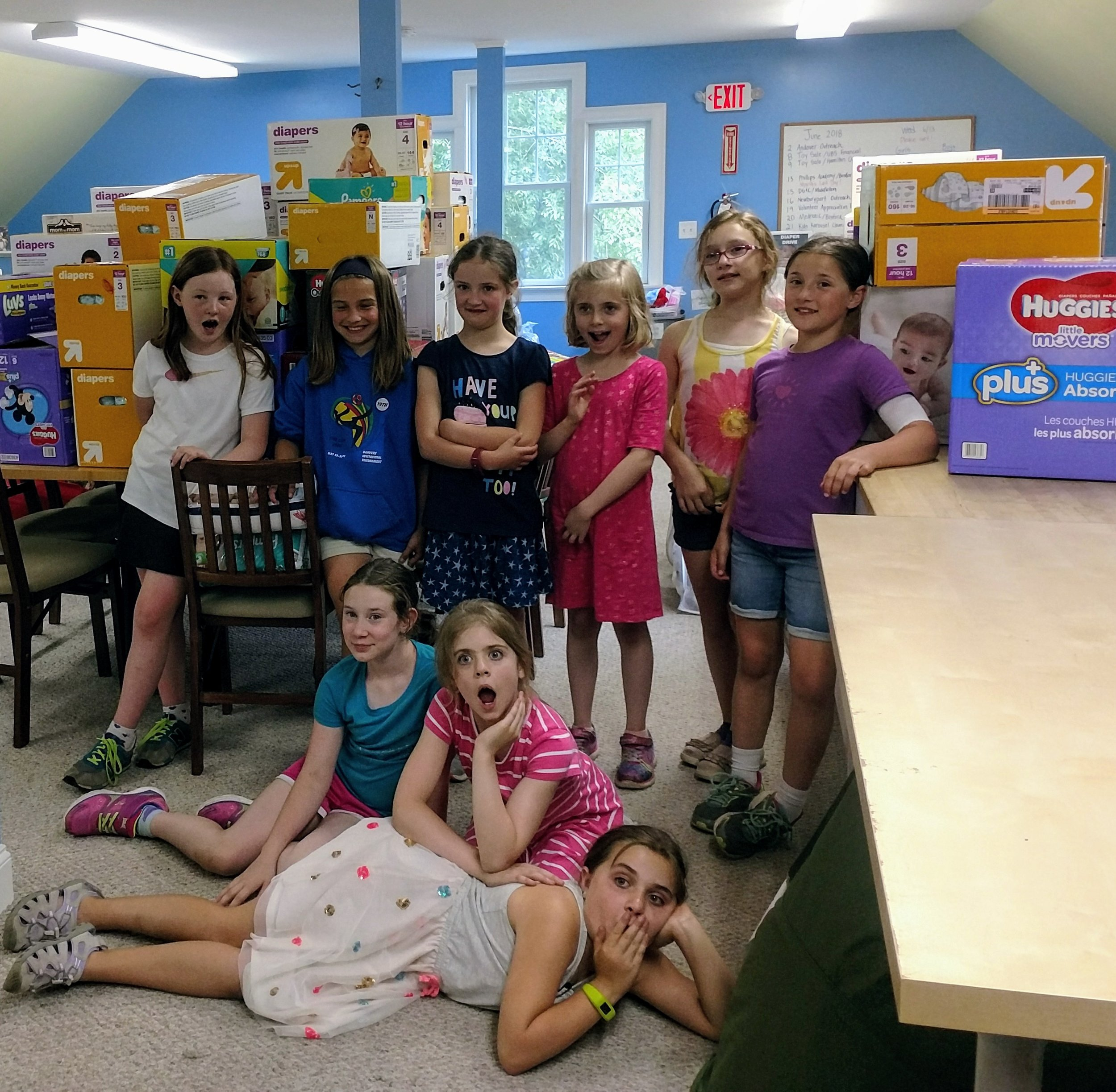 A local Brownie Troop collects a boatload of diapers for Community Giving Tree's Show The Love For Babies program