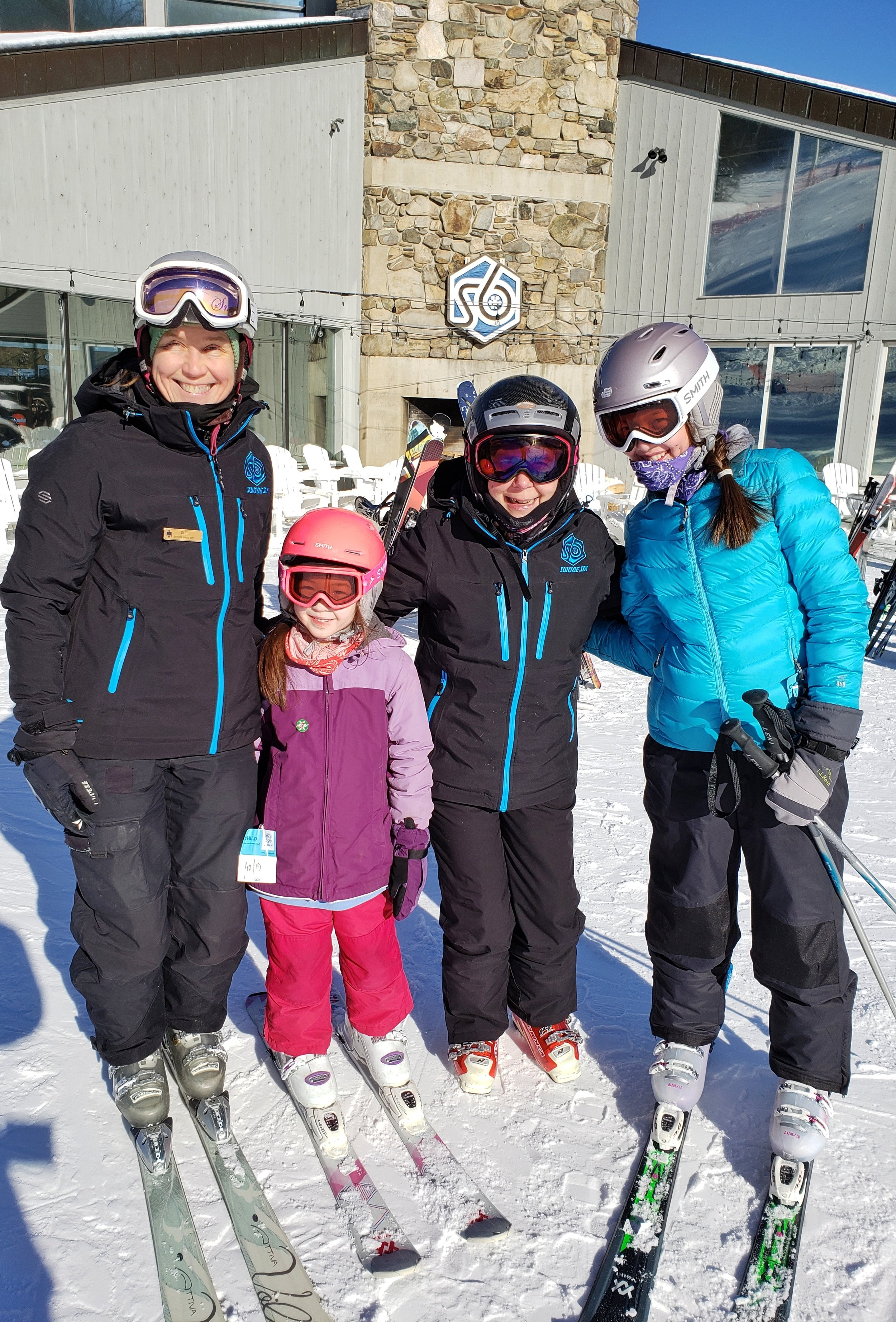 Laurel and Violet with their ski instructors at Suicide Six
