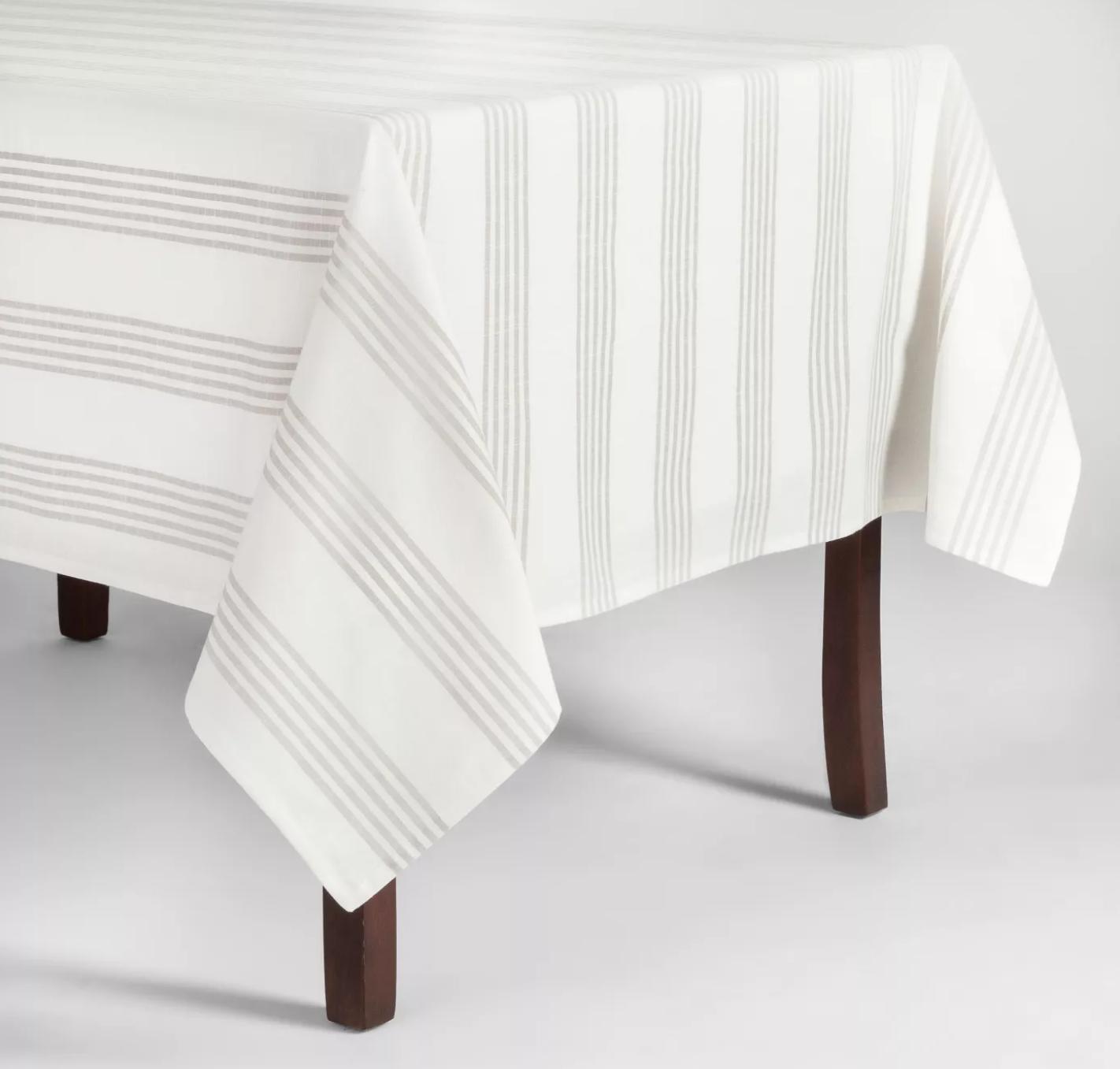 Threshold gray stripe tablecloth; image via Target