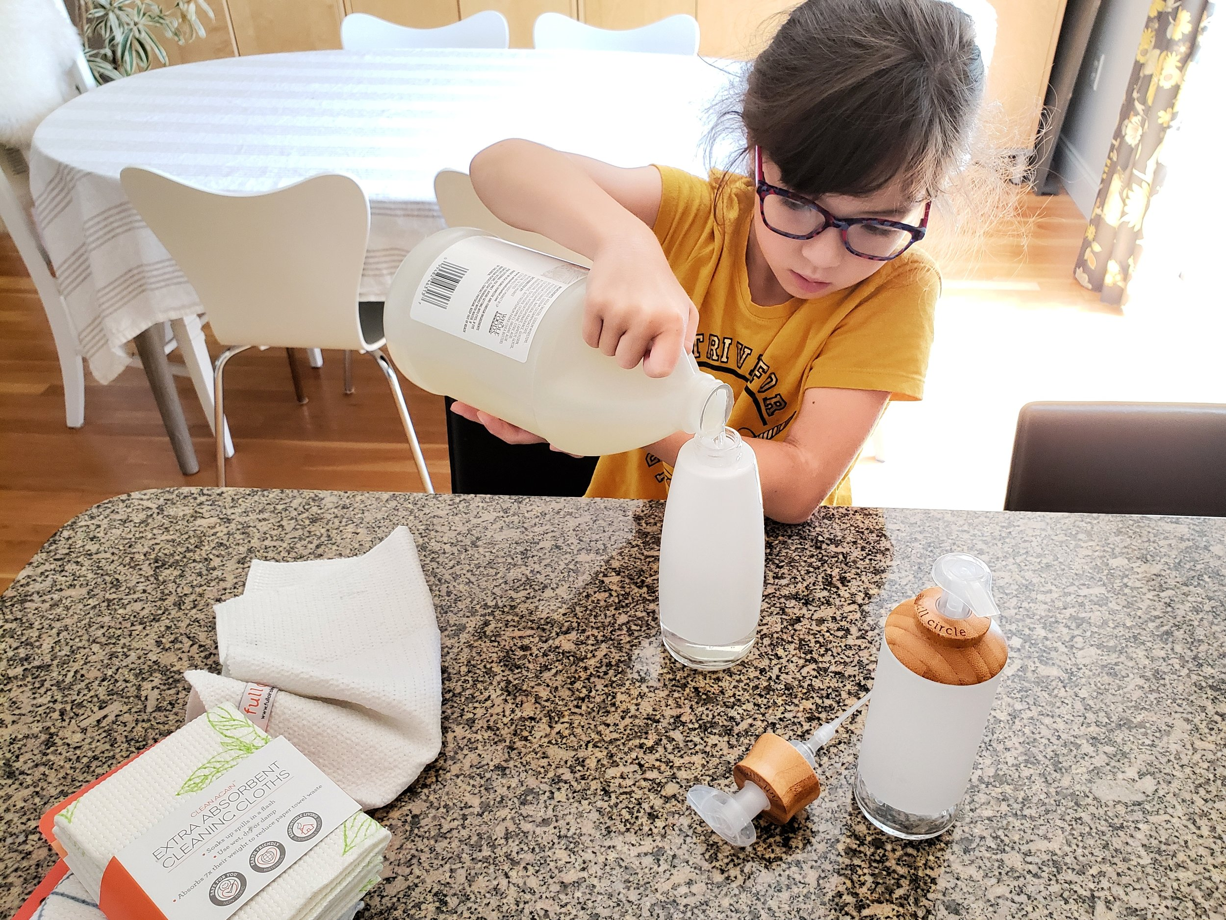 Have kids refill soap bottles on a counter or at the bathroom sink; if they spill soap, they can use it to clean up the surfaces!