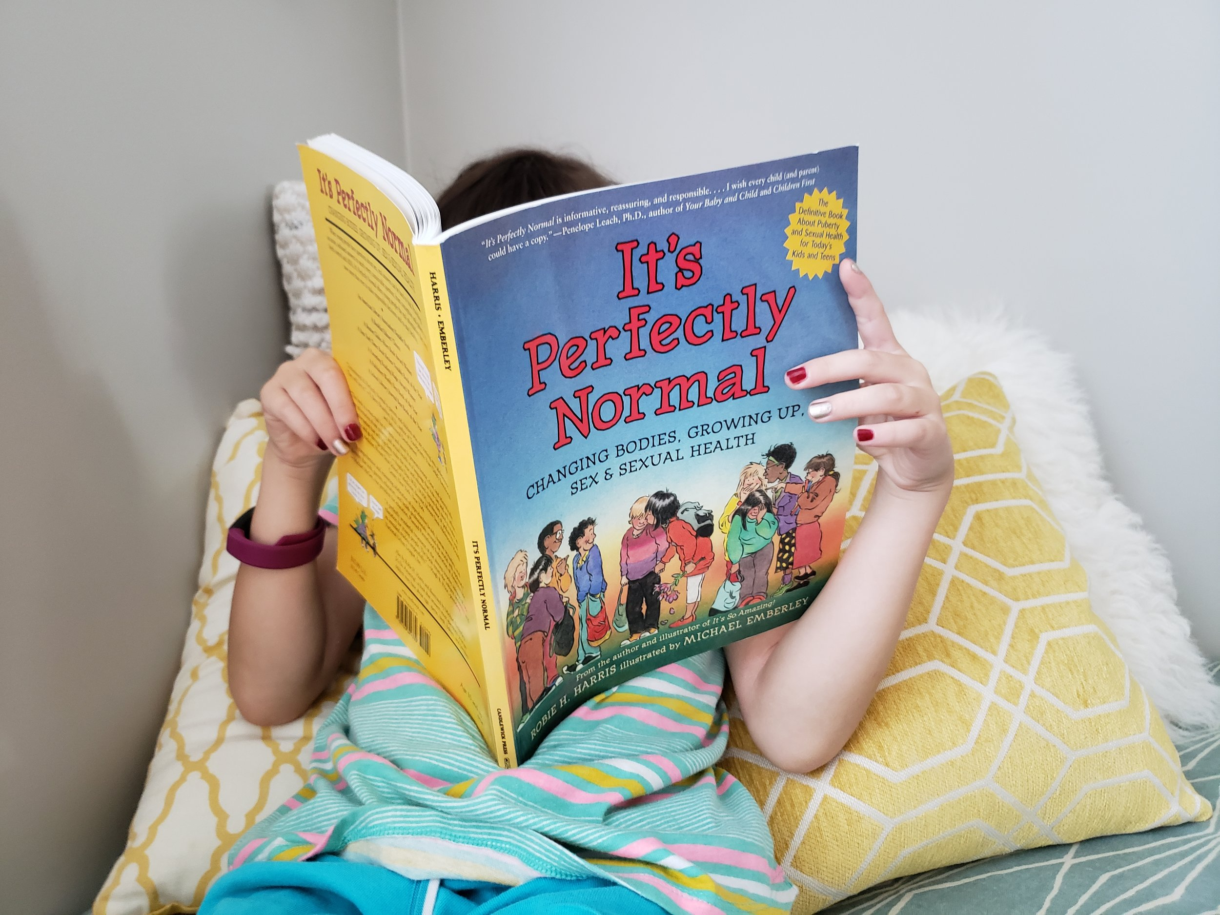 "Violet is only 8 but she is super into ""It's Perfectly Normal"" by Robie Harris"