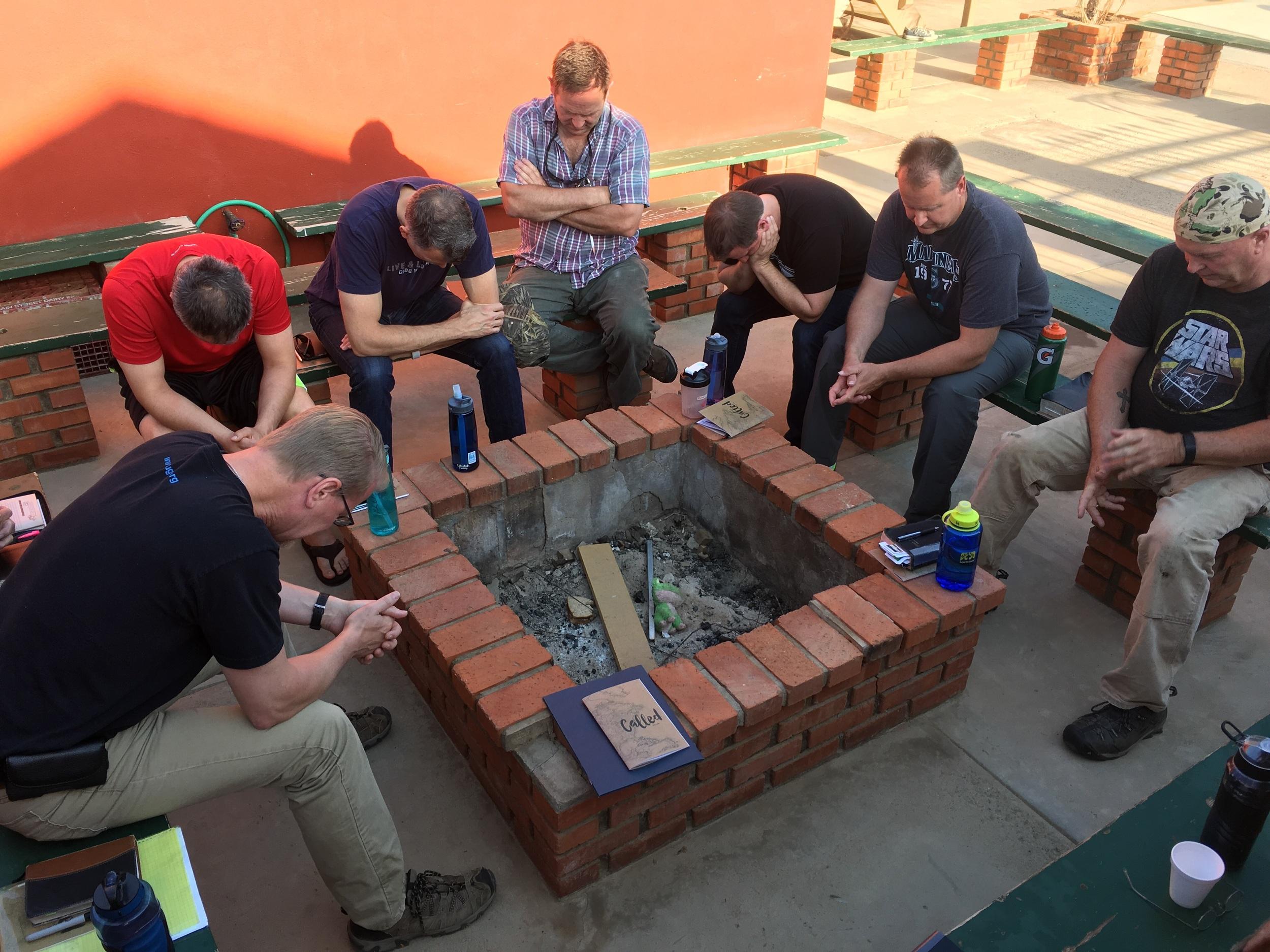Men praying for the day
