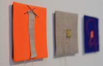 "Micro Knitting // ""Tiny"" Exhibit // Ypsilanti Art Incubator // Ypsilanti, MI 2014   Knits appx 1""x1"" each, mounted on 4"" x 4"" canvas   Sewing needles, thread, fabric"