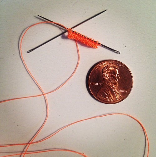 "Micro Knitting // ""Tiny"" Exhibit // Ypsilanti Art Incubator // Ypsilanti, MI   Knits appx 1""x1"" each, mounted on 4"" x 4"" canvas   Sewing needles, thread, fabric"