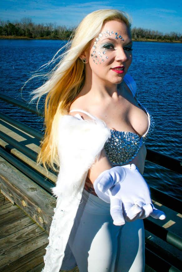 "Emma Frost- Xmen  Cape and bra done by me, and if I EVER say I will remake this lock me up because I lost it. The bra and pants was purchased, but I added individual rhinestones to the bra one by one. The cape (which you can't tell from this picture) is two layers. The bottom layer has LED lights sewn onto it. The top layer was added after the LED's were sewn in and I pulled and white glued them in place to the top velvet layer. This was SUPER time consuming and tedious. Then for the finishing touches I added the white fur. This cape SCREAMS Emma since the LED's glitter and glisten.  I will get photos of this in the snow if it's the last thing I do!  Emma was chosen because simply I love glitter and the fact that she uses her sexuality as a strength, especially in a time where ""slut shaming"" is the normal.  Photo By John Penta of C&C Media Design:   www.facebook.com/CCMEDIADESIGN1"