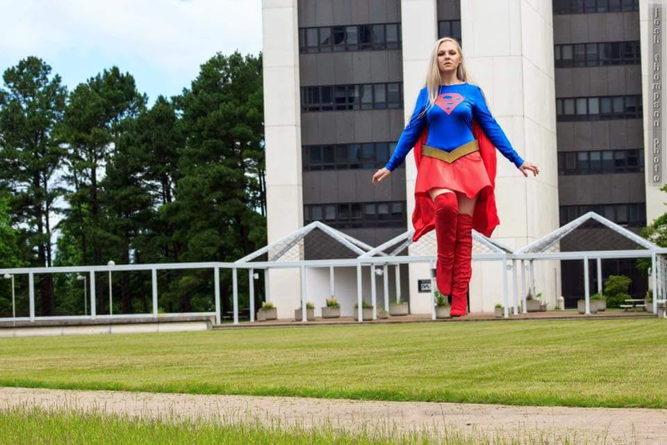 Supergirl-DC Comics  100% done by me. Used the simplicity body suit pattern (and heavily altered the booty portion), made a circle skirt, free handed the cape pattern (I was being risky), and made the belt out of foam.  She always needs some sort of TLC because she is my most worn cosplay. She is the one I take to the children's hospital for visits. Honestly her personality matches mine the most. When I wear her I am ALWAYS surrounded by awe struck kids, which makes me feel...well...Super!  Photo by Josh Thompson of Josh Thompson Photography:   www.facebook.com/joshthompsonphoto