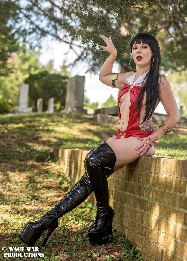 Vampirella  100% done by me. Arm band is foam (she shares with Wondergirl) and the body suit was made by me. I used a bathing suit of mine to make a pattern. Then had to HEAVILY alter the pattern. Added a washer for the center ring and most importantly teeth were custom made by Horror Show Jack Fangsmith    Vampy is a personal favorite of mine. She makes me feel dangerous and sexy. The comics are also a favorite. Her character is way more than just a body and I love that about her!  Photo by: Jonathan Gibson of Wage War Productions:   www.facebook.com/WageWarProductions