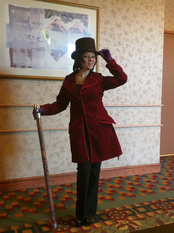 Willy Wonka (Johnny Depp Version)  Cane and W necklace is made by me. The cane is easily 7-8lbs. I really need to make it lighter. I also had to tailor the jacket since it was HUGE on me. This was my first time altering a jacket and let me tell you, it's not fun.  First thing about me is I'm a Tim Burton fanatic! I had the jacket since the movie came out, but since I couldn't sew, it sat in the back of my closet and never saw the light of day. Since cosplaying I have learned how to sew and when I got a dress form this was the first thing ever put on it. It was FINALLY Willy Wonka's time to shine! Speaking of, I need to get an actual studio picture of this. He deserves it.