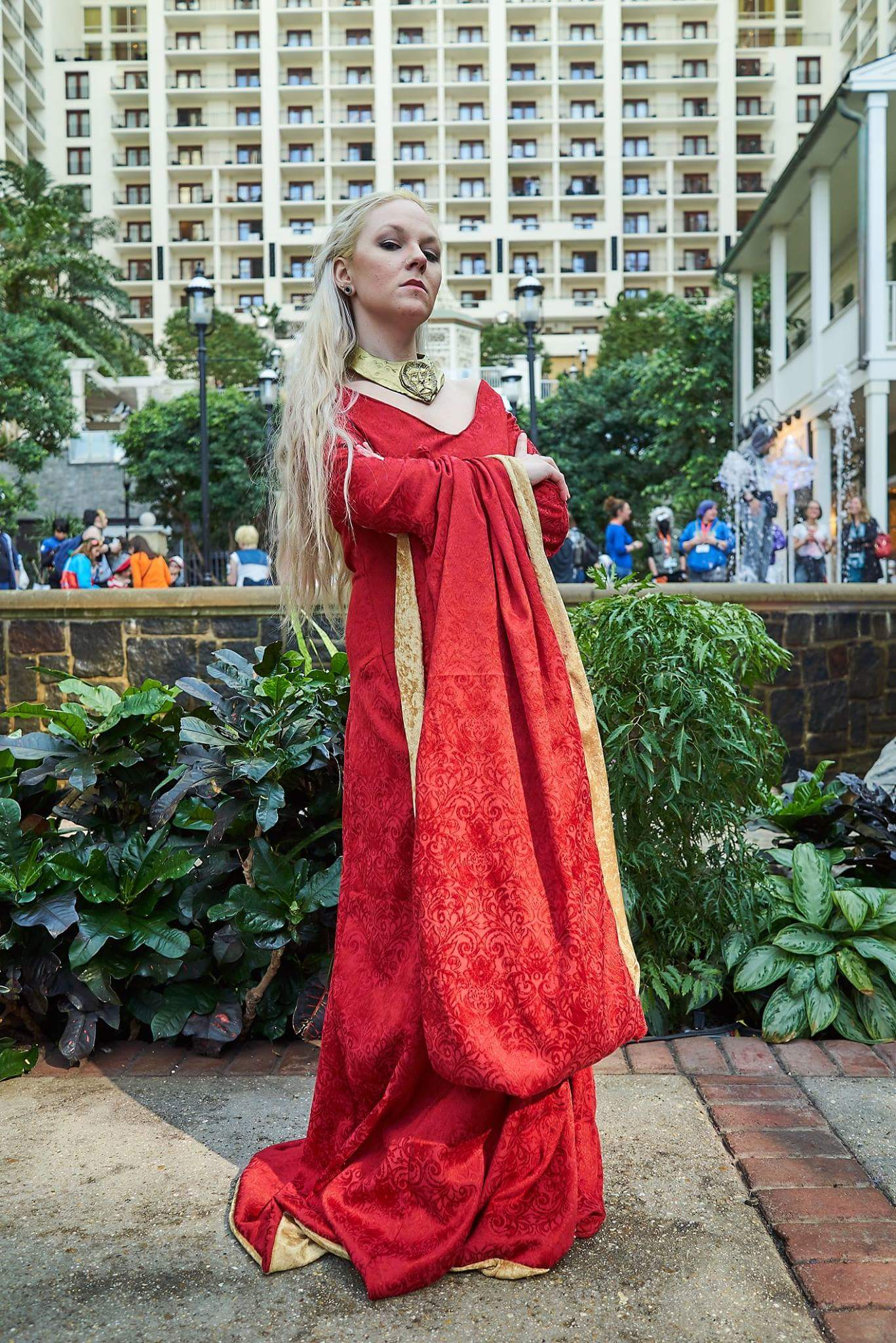 Cersei Lannister- Game Of Thrones  I can finally sew well enough! YAY!  100% done by me  I've never been so proud of a sewing project before! I used McCalls M6940 pattern for this. The base of the necklace is thin craft foam and worbla. I sculped the lion out of super sculpty and baked it(after the dragon casting fiasco I wasn't risking another failed cast). I glued it onto the worbla with contact cement. Plastidipped (white) and finished with gold spray paint.  Then you add a bitchy attitude and a lot of eye rolling.  She's so much fun to play.  Photo by:  www.facebook.com/owlbearmedia