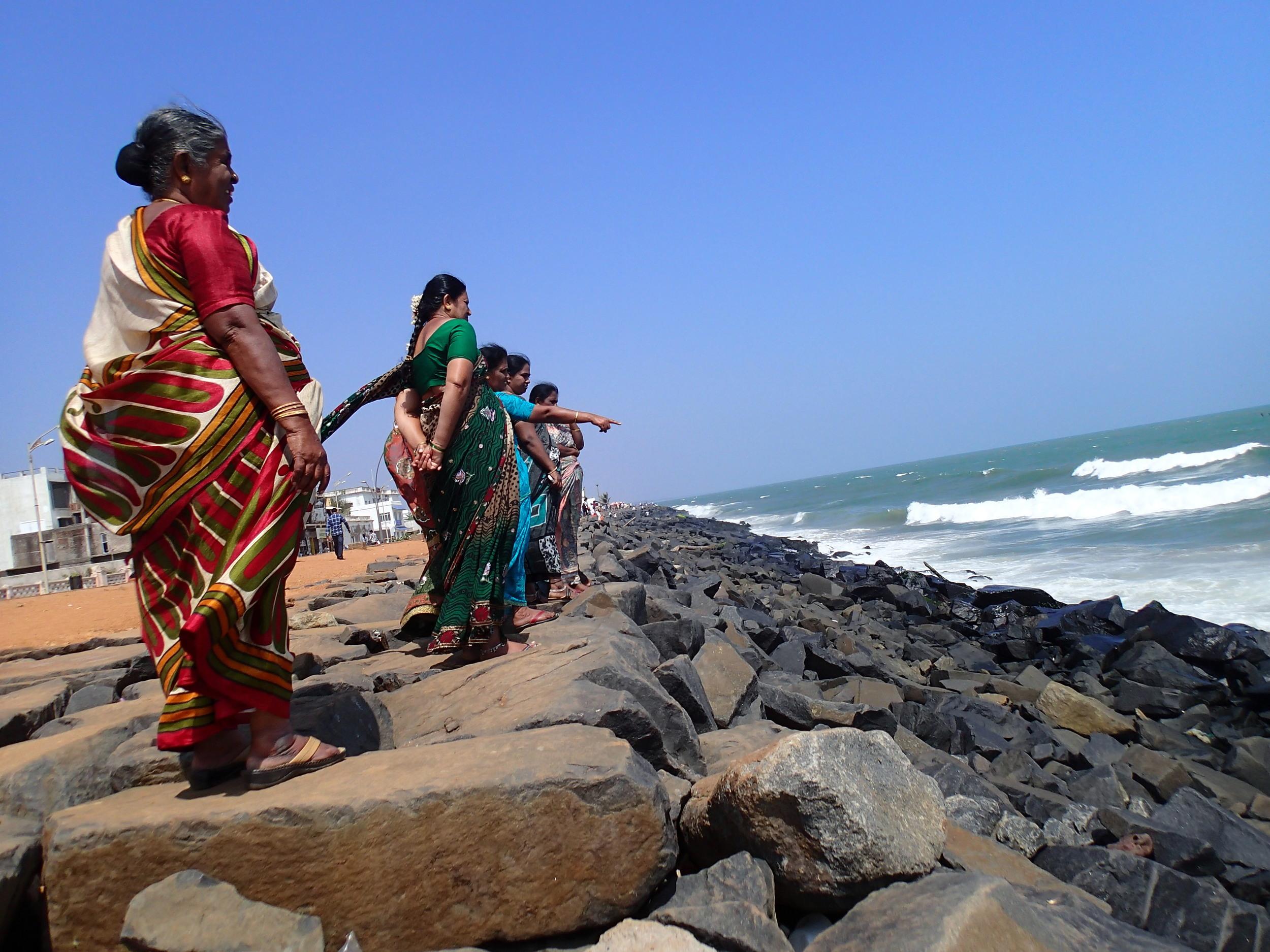 Women on the breakwater, enjoying the sea breeze