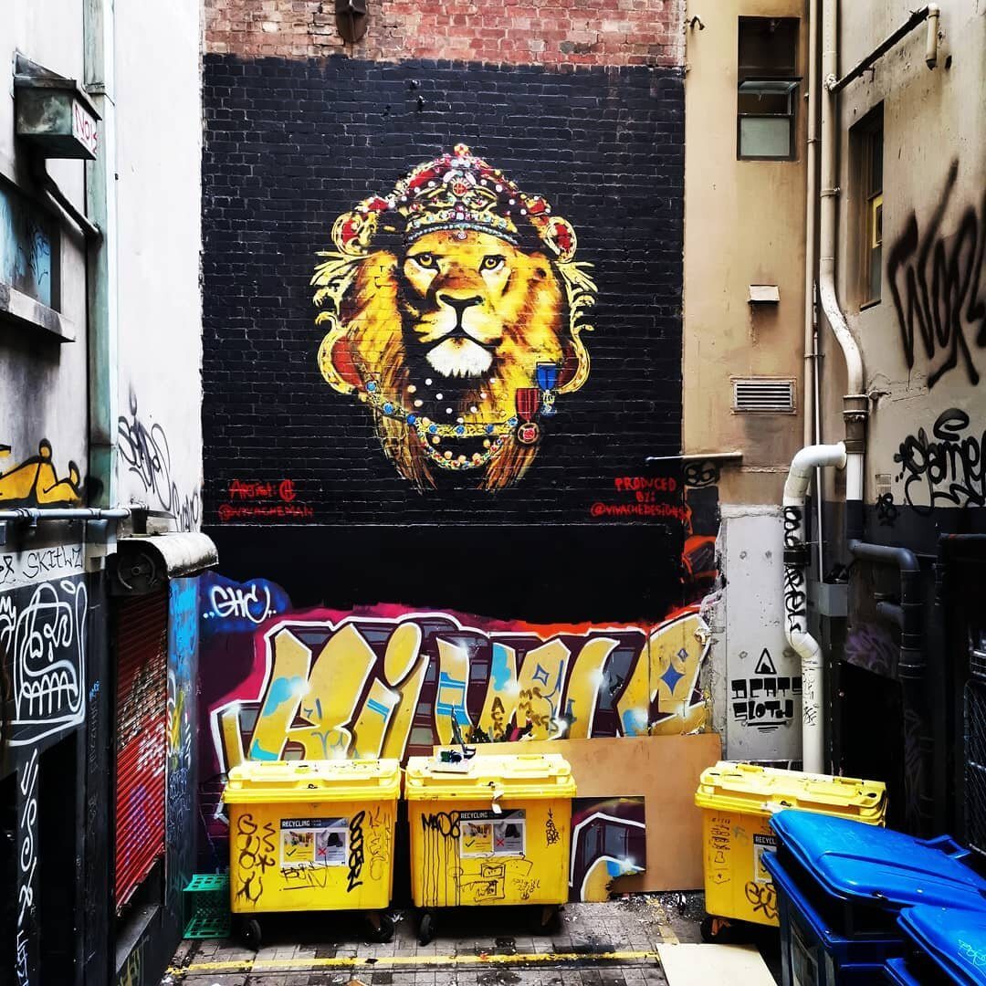 Mural painter Che paints this Street Art mural Lion King Mural in the heart of Melbourne Street Art Epicenter.