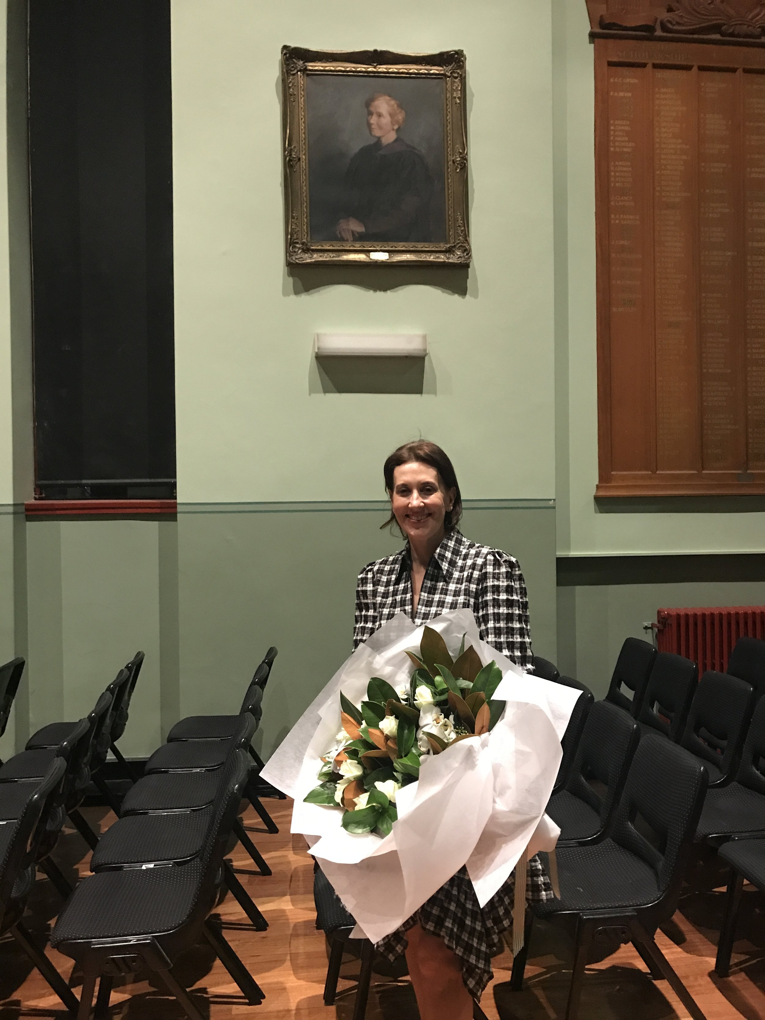 Virginia Trioli with the portrait of Christina Montgomery at the fourth annual Christina Montgomery Oration, 24 April 2019.