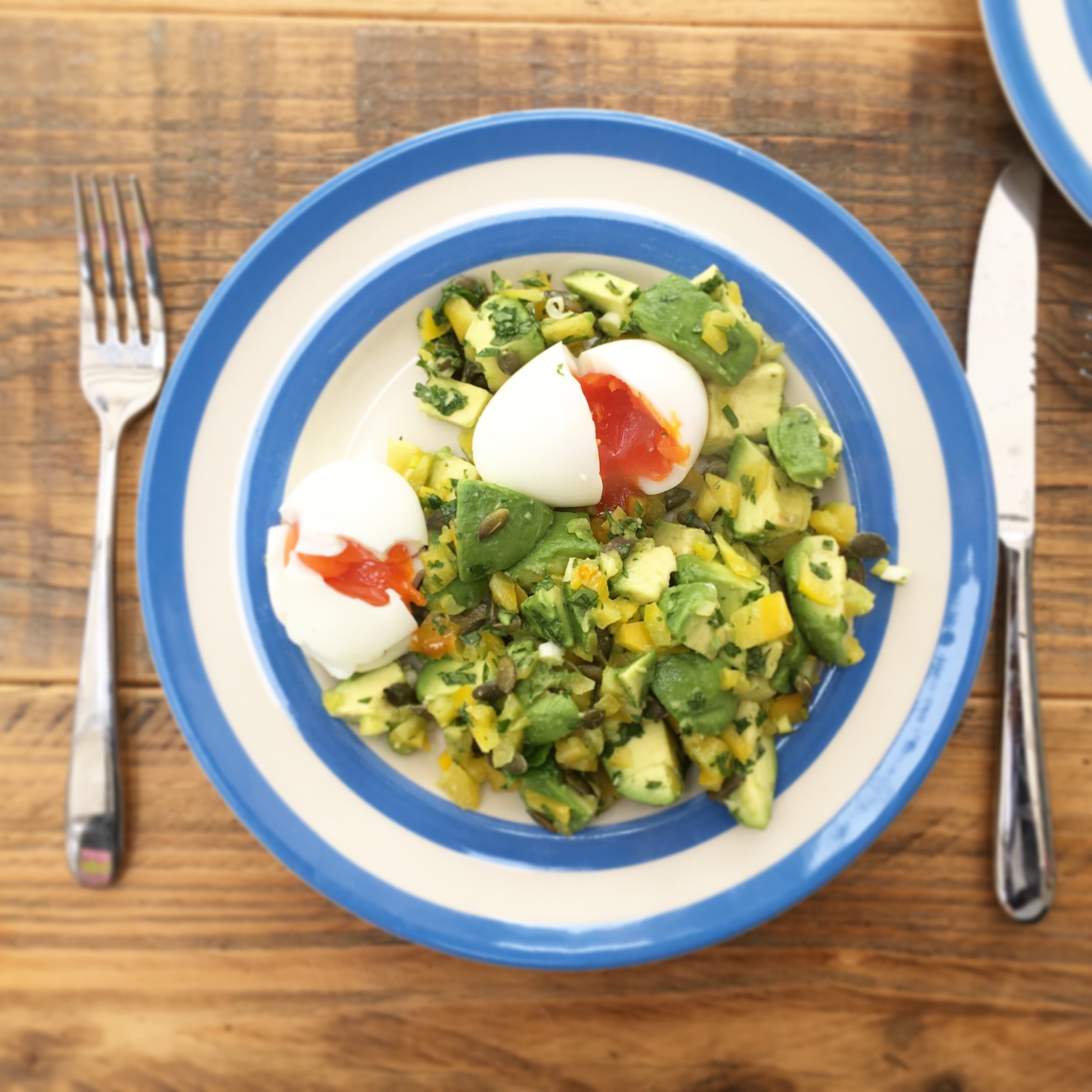 soft-boiled eggs with avocado salad