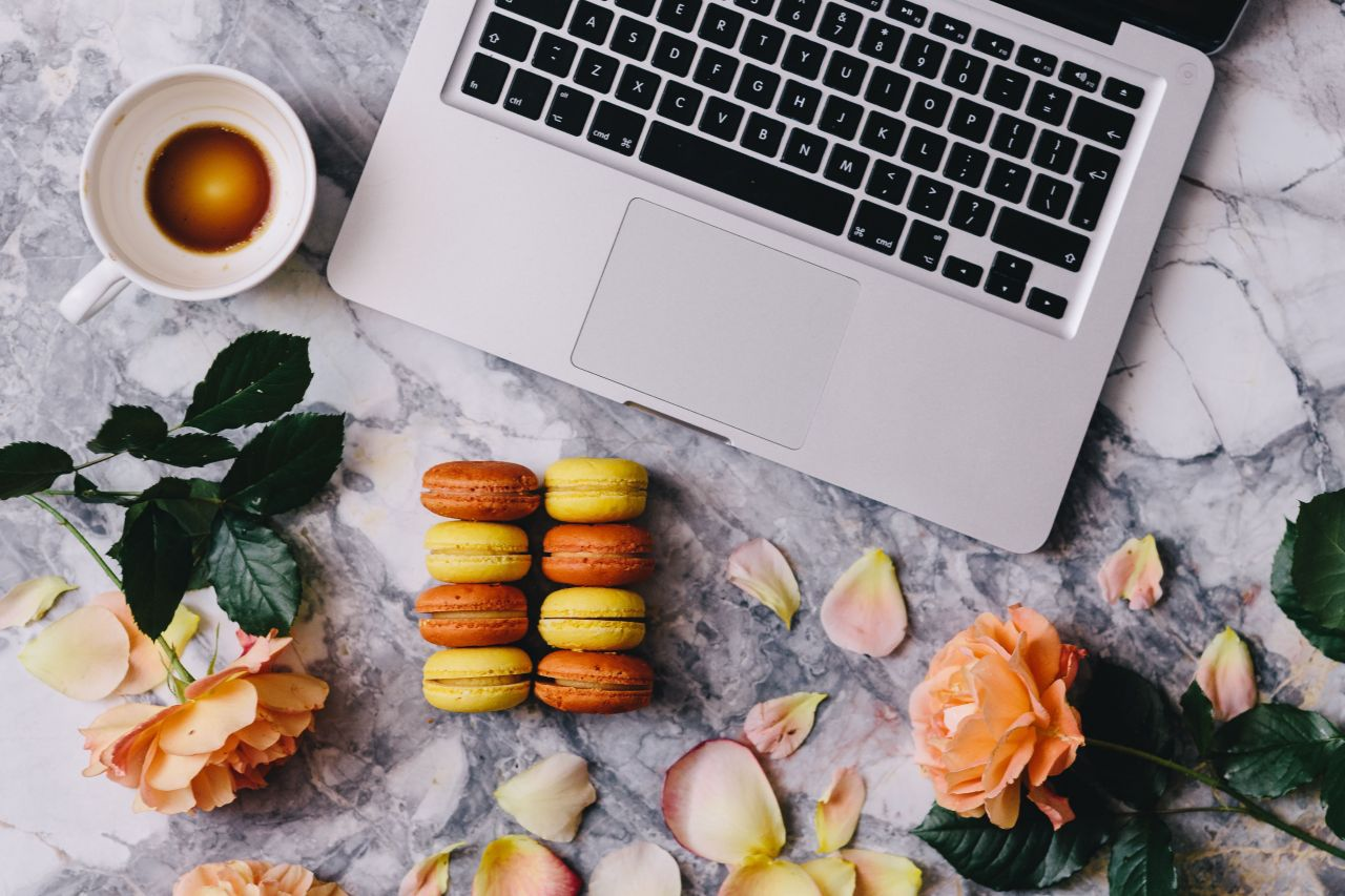 Copyediting laptop with biscuits