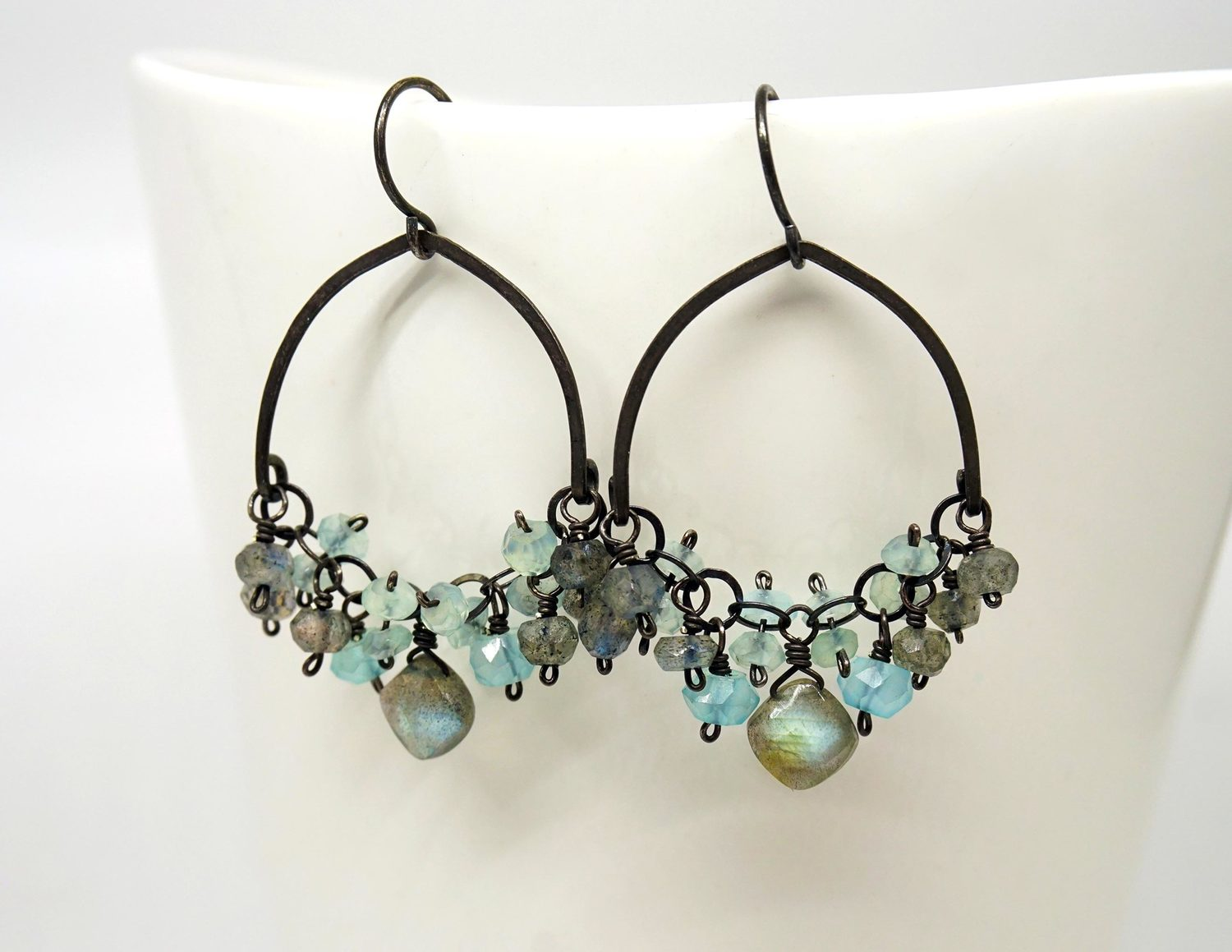 Calliope - Seatlle, WA.  Earrings, necklaces, & bracelets of oxidized sterling silver with pearls or semi-precious stones.