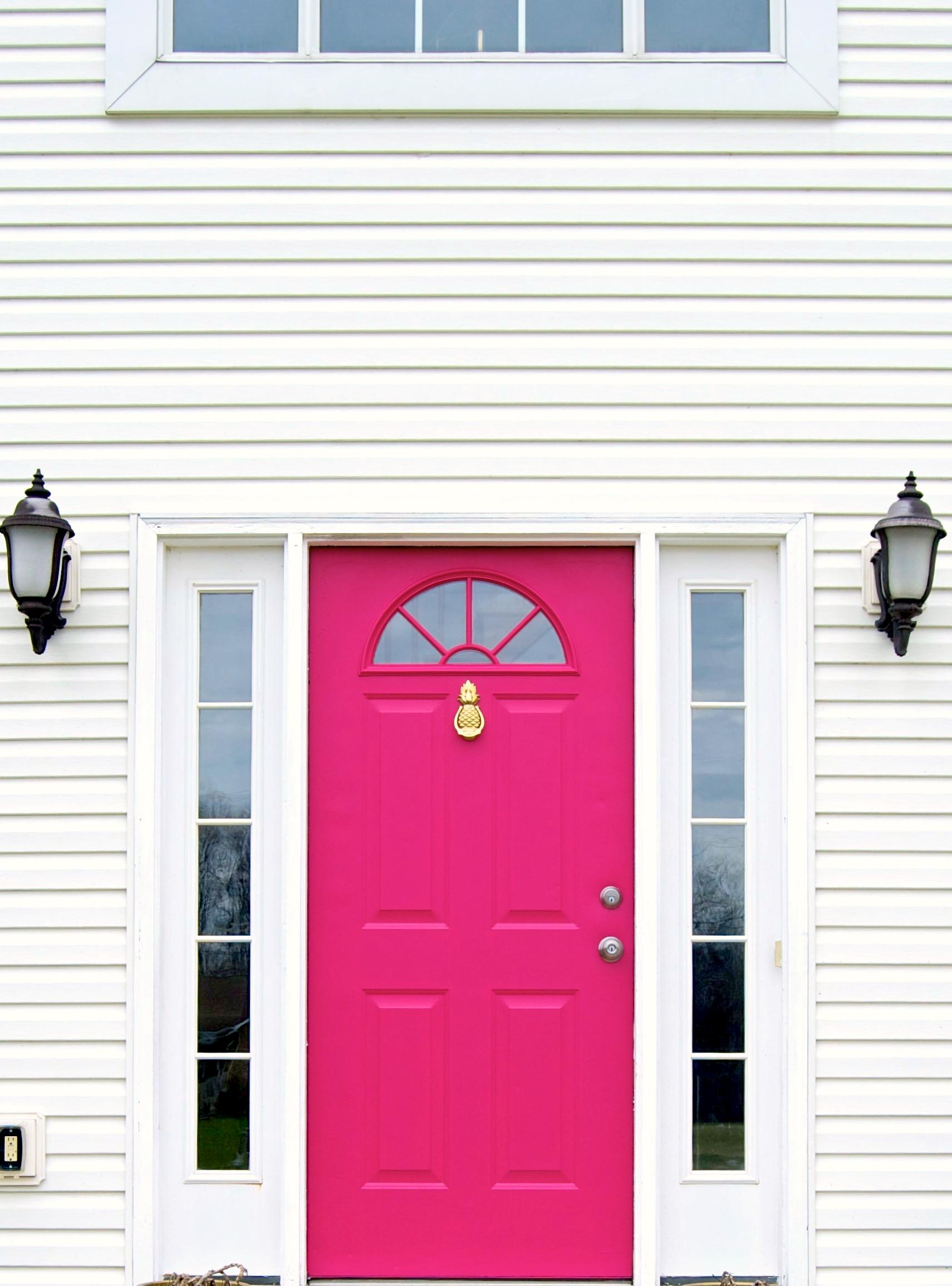 Hot Pink Door With Brass Pineapple Doorknocker. This door was painted with Behr Exterior Paint in Pagoda. See more details at ericahammer.com/blog