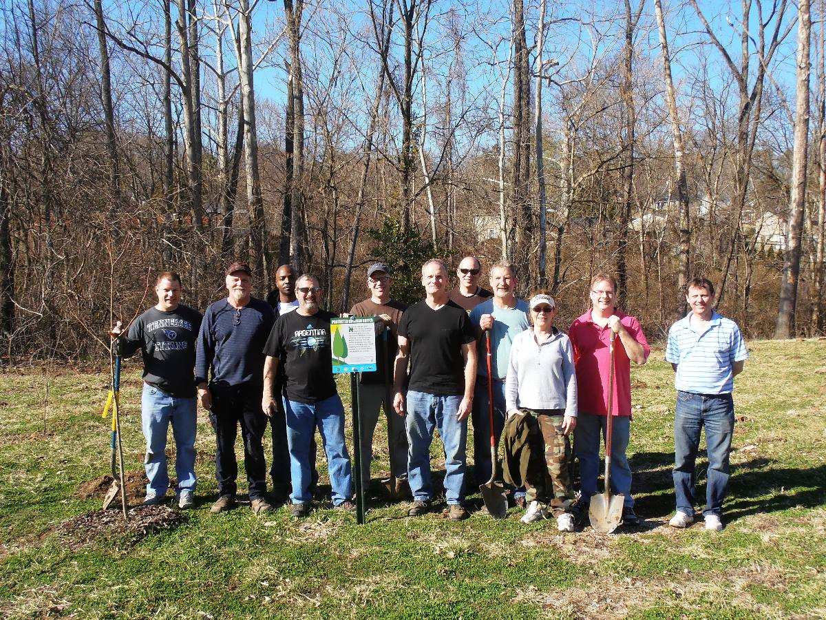 In March of 2013, volunteers from Triumph Group planted trees along Whittemore Branch on Benzing Road.