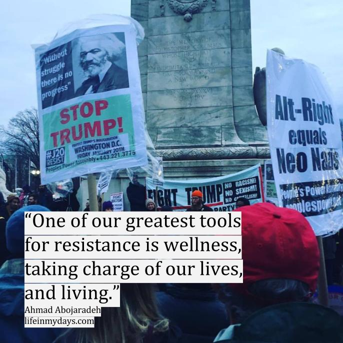 "Photo Description: A group of protesters carrying Stop Stump signs in Union Square in Washington DC, with the quote ""One of our greatest tools for resistance is wellness, taking charge of our lives, and living."