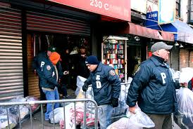 Police raids on vendors selling counterfeit product on Canal St., Chinatown, NYC.