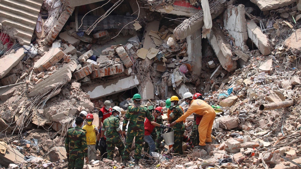 Emergency workers rescuing survivors from the Rana Plaza factory collapse April 24th, 2013.