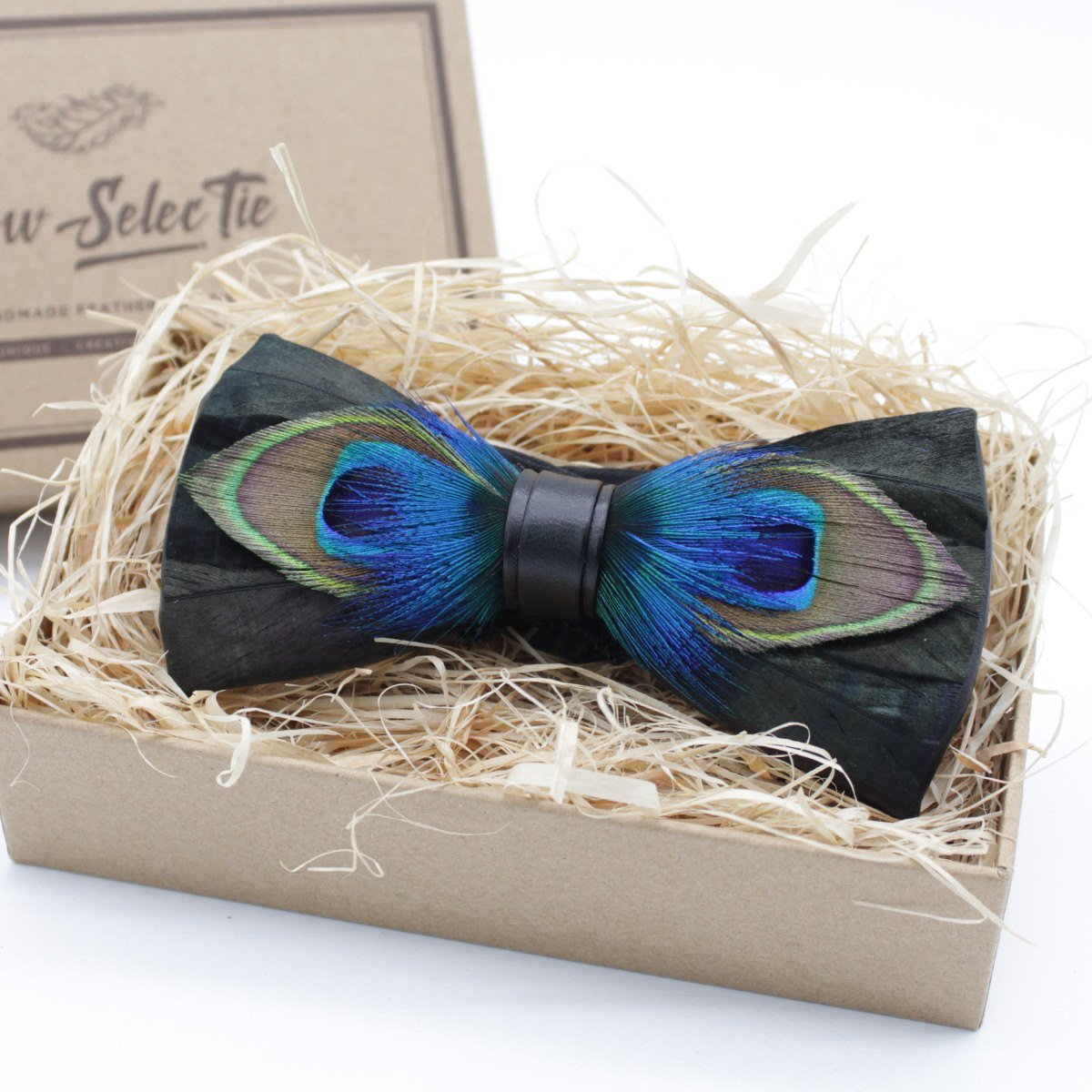 BRACKISH BOW TIES  is a Bow Tie brand made in Charleston, SC.  No dyes are used, giving each tie a unique coloring. The feathers are all-natural and sustainably sourced. Each tie arrives in a hand-branded, pine gift box. including a list of the feathers used and instructions on how to care for your tie.  www.brackishbowties.com