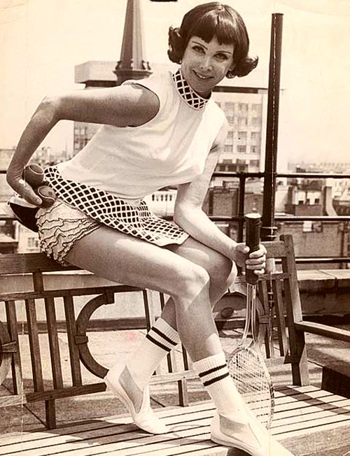 Pro tennis player Gertrude Moran scandalized the tennis world by wearing a tennis dress so short you can see her ruffled knickers.
