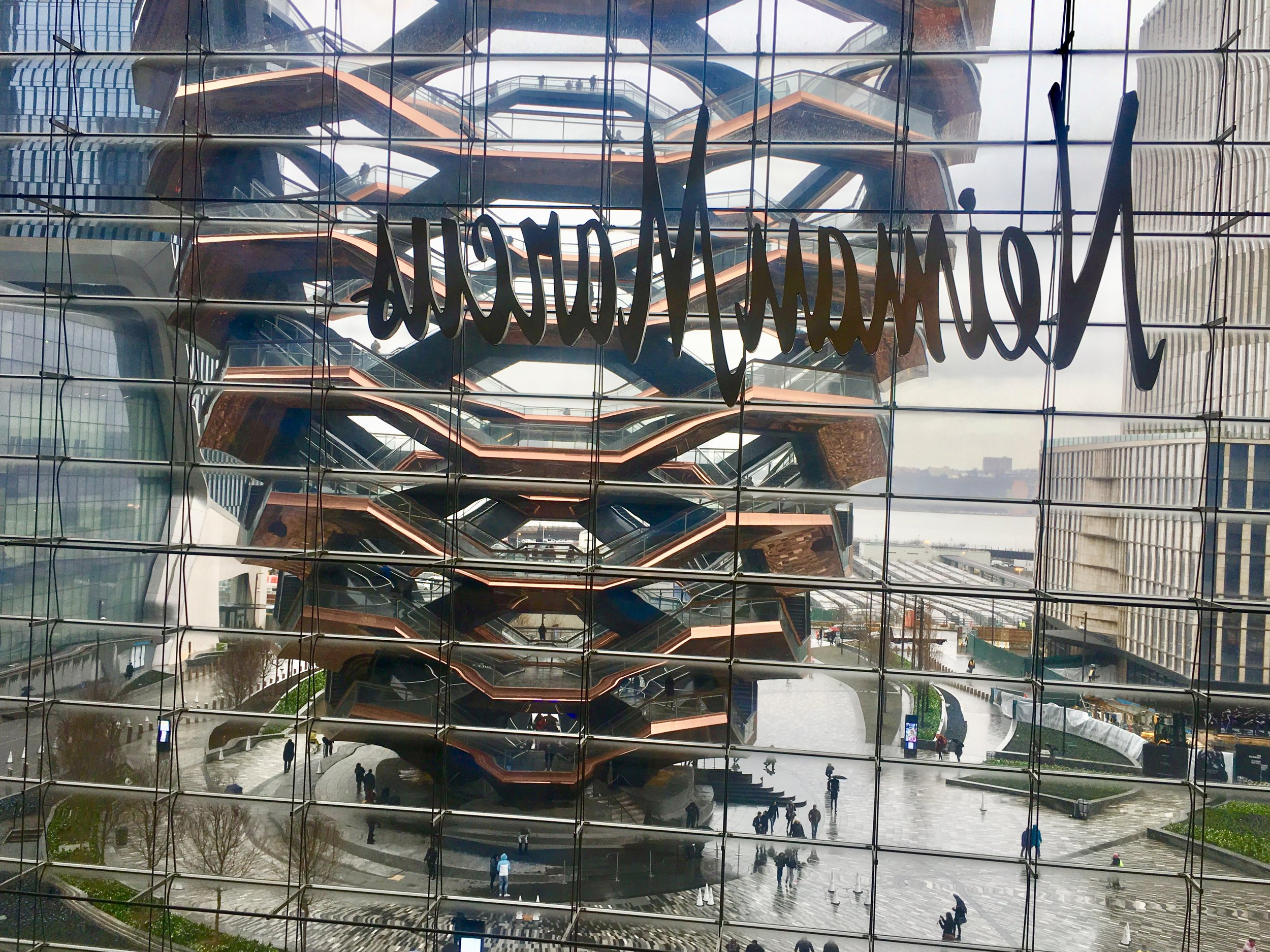 A view of The Vessel and the trains lined up in at Hudson Yards from the interior.