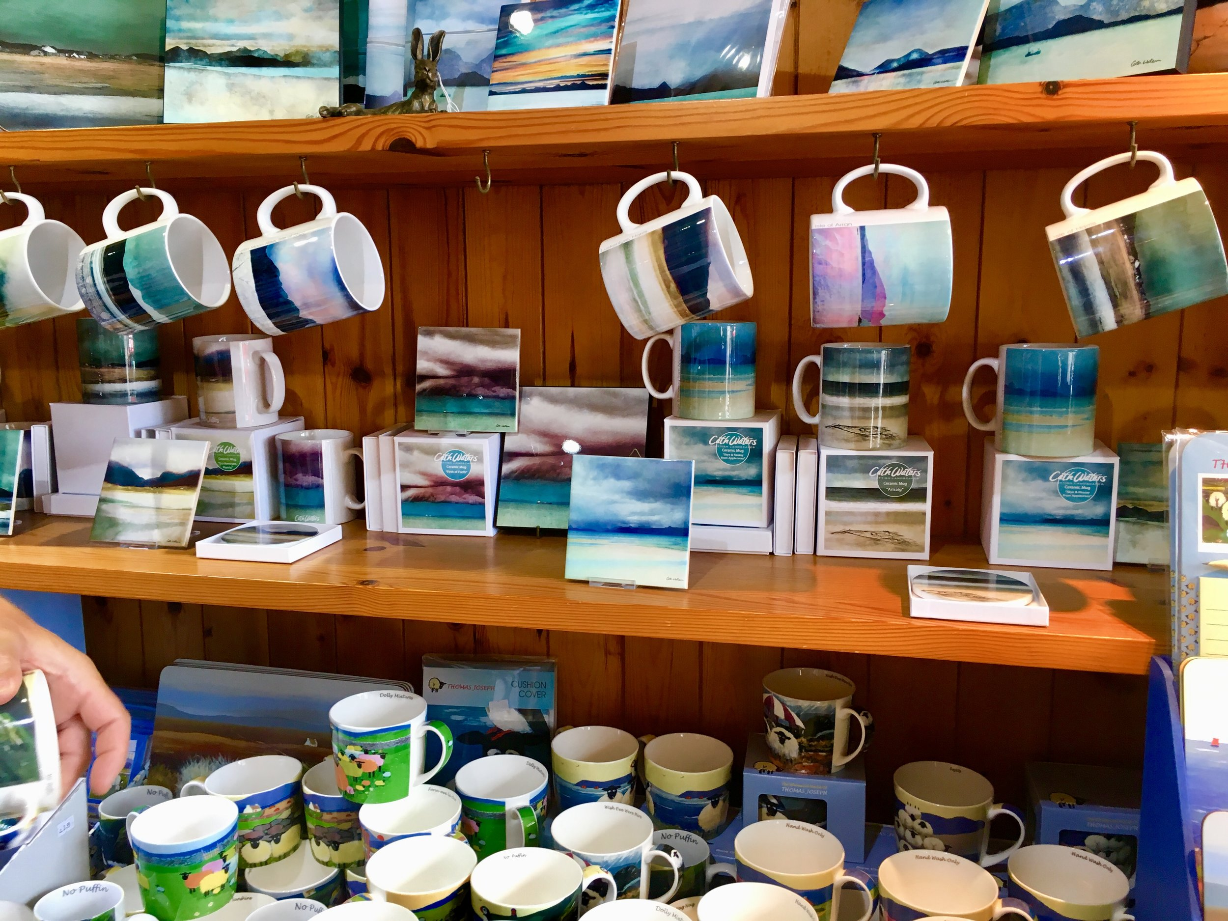 The selection of mugs with abstract vistas is a popular sell at Mull Pottery.