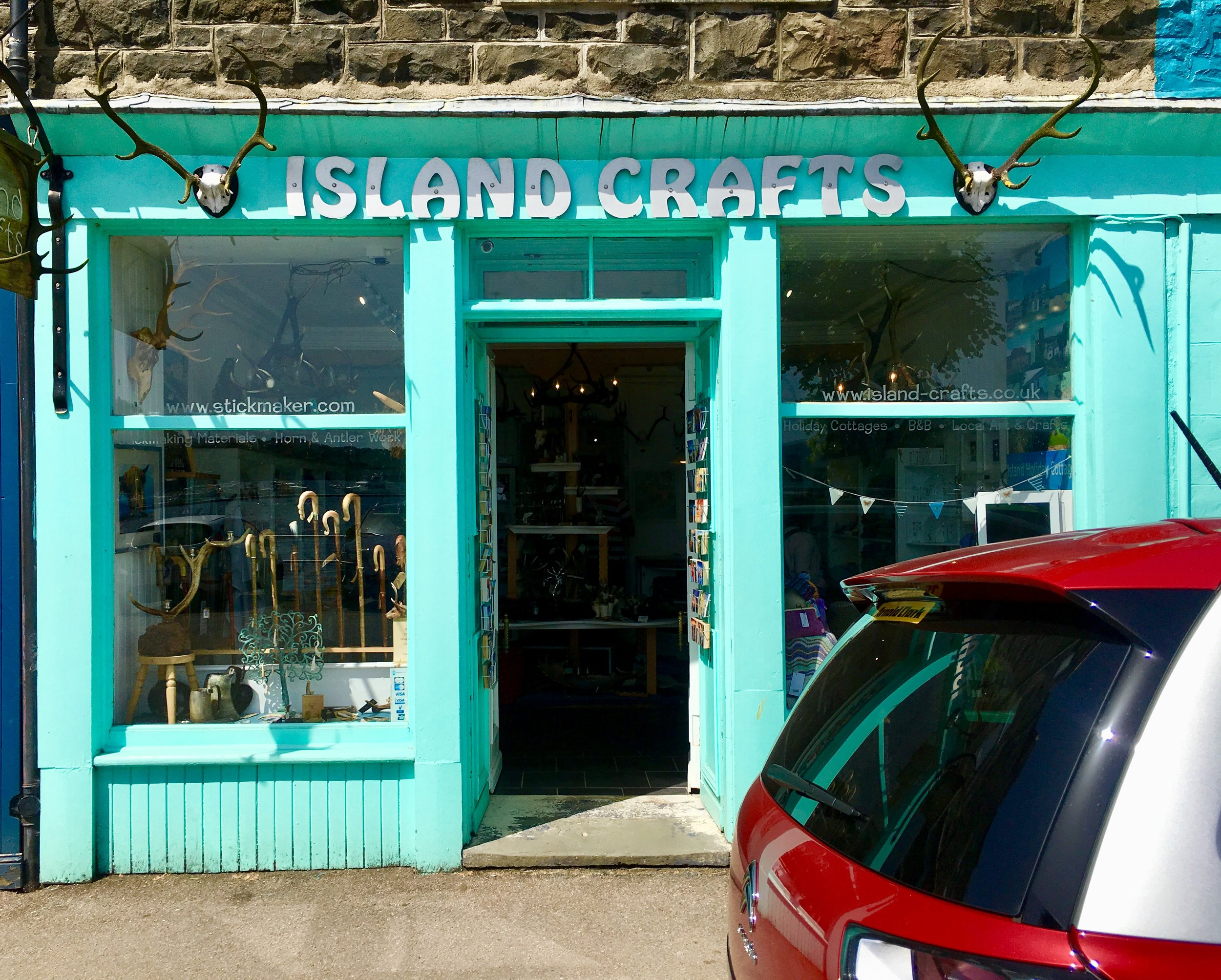 The sea-green shop of Island Crafts.