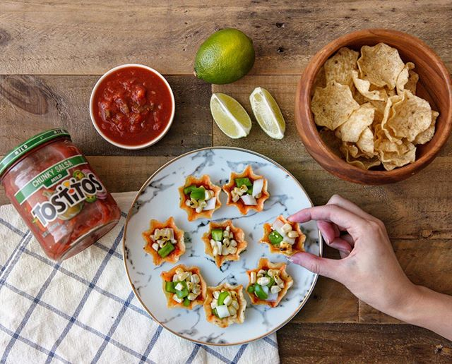 I partnered with @Tostitos to bring you this Tostitos Chunky Salsa recipe. This easy corn dip adds sweetness and crunch making it a great compliment to Tostitos Chunky Salsa. Can't stop snacking it!  Ingredients  1) 1 jar of  Chunky Salsa 2) 1 bag  Tostitos  scoops 3) 2 ears of corn 4)  1 Green Pepper, diced 5) 1/2 Onion, diced 6) Lime, olive oil, salt, & pepper to taste  Directions  1)  Brush corn with olive oil and grill for 8 minutes, or until the kernels begin to char. Let cool slightly and slice the kernels off the corn with a knife.  2)  In a large bowl combine corn, green peppers, and onion . Mix in olive oil, salt, black pepper, and lime juice to taste.  3)  Serve with Tostitos Scoops and Tostitos Chunky Salsa.  @Tostitos #getothegoodstuff #ad