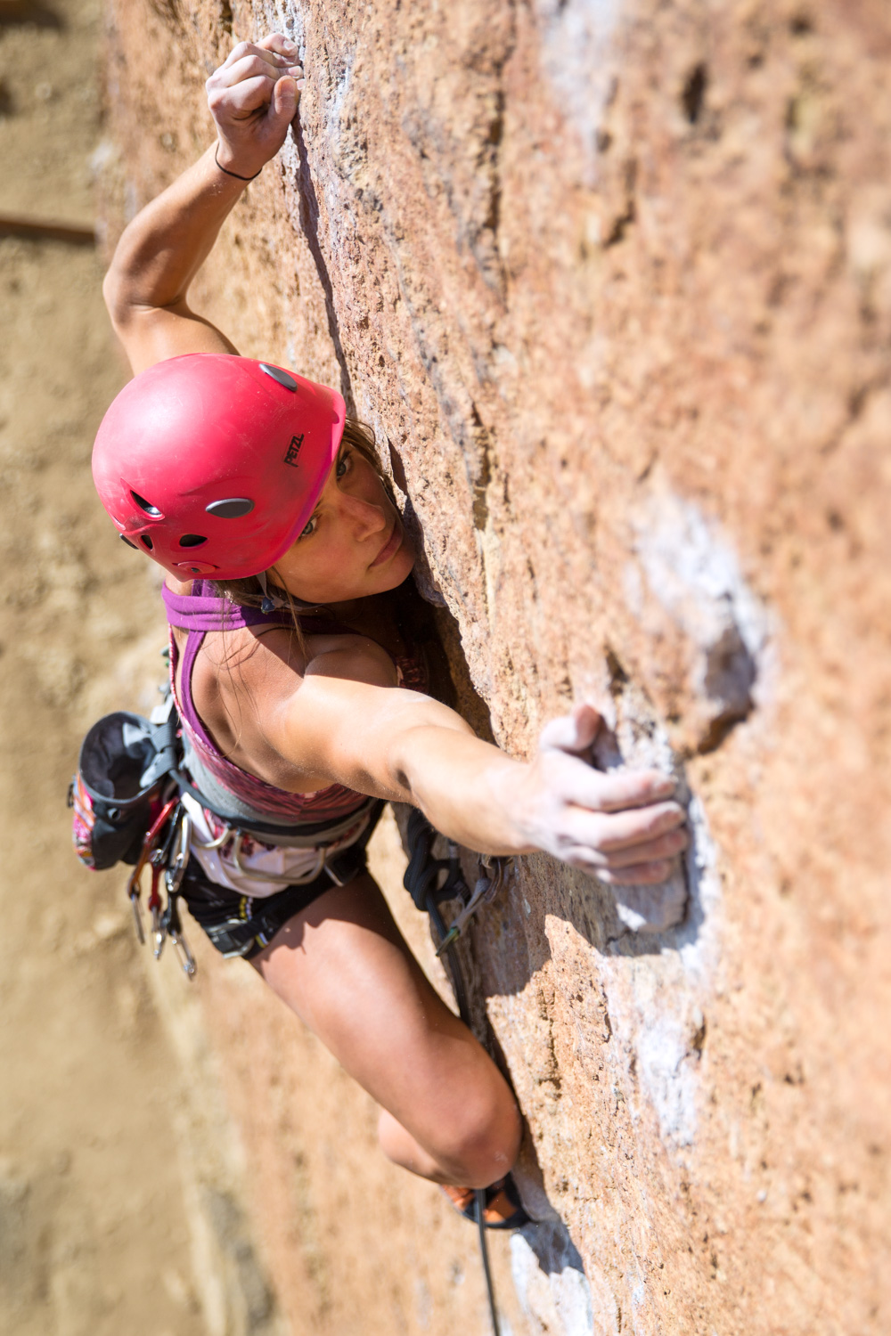 Lisa Chulich reaching for a hold. Smith Rock, OR