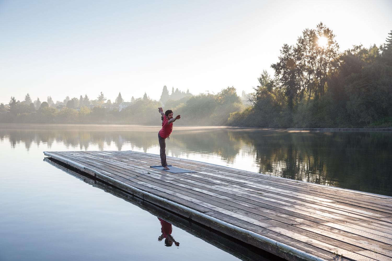 Scott Rinckenberger doing yoga at sunrise. Green Lake, WA