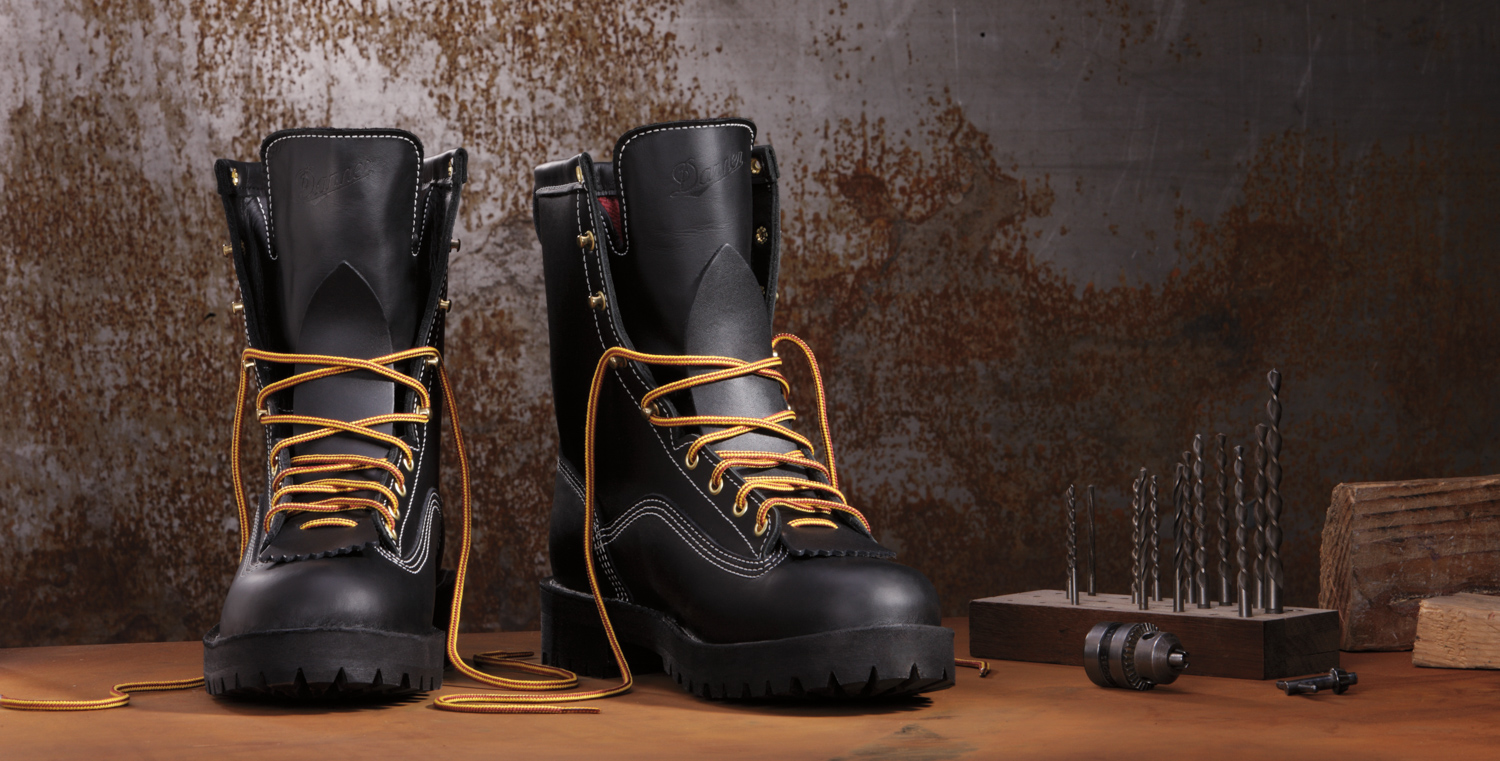 Product photography shot in studio: pair of black Danner boots