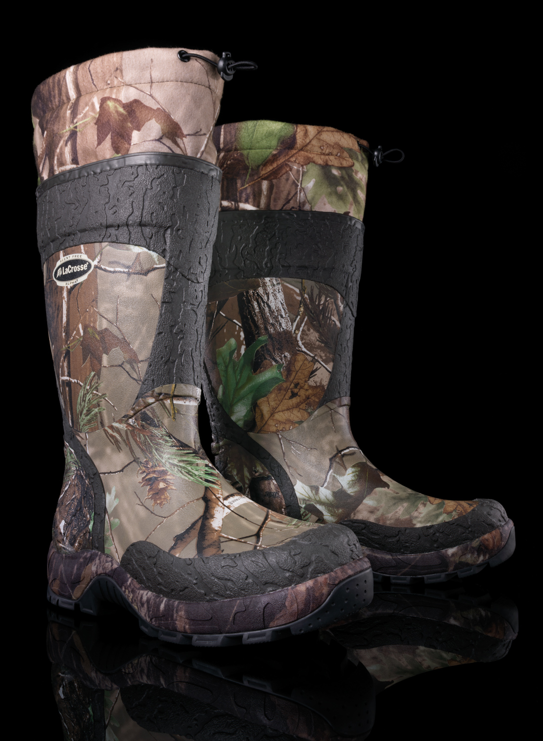 Example of product photography shot in studio: pair of camouflage water proof boots.