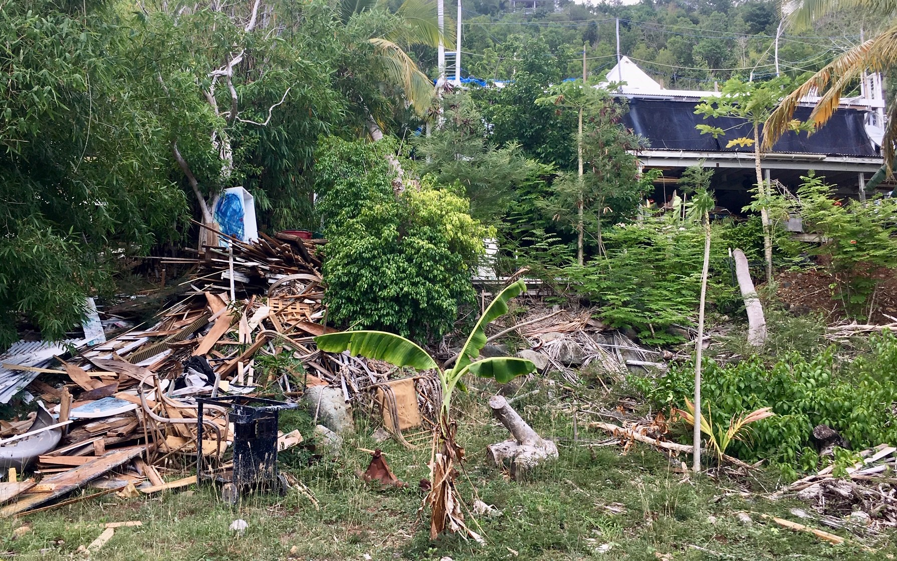 The mountain of debris at the artist's house. the top floor of the house is completely gone.