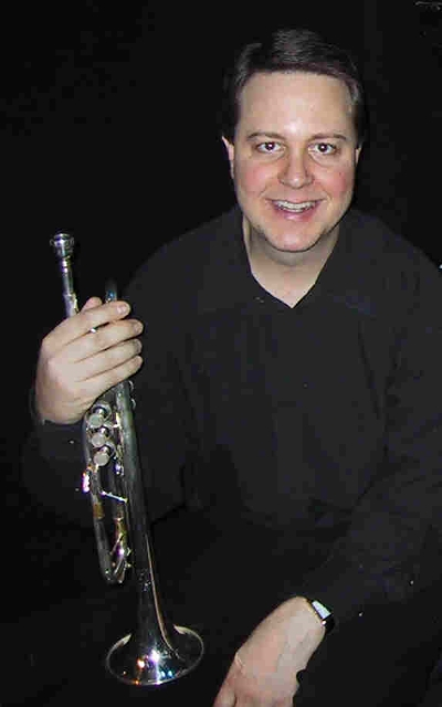 Jon Owens - Lead Trumpet / FlugelhornAfter graduating from the Eastman School of Music, Jon Owens toured the world extensively, performing in over 25 countries with Maynard Ferguson, the Woody Herman Orchestra, and Blood Sweat and Tears. He has performed and/or recorded with Sting, Aretha Franklin, David Byrne, Bill Bruford, Deep Purple, Tony Bennett, Wynton Marsalis, Ron Carter, Maria Schneider, Chico O'Farrill, Dave Liebman, Doc Severinson, Linda Eder, Michael Feinstein, and the NY Pops Orchestra. Jon has performed on many commercial jingles and movie soundtrack recordings. His discography includes over 50 CD recordings. Currently, Jon is a member of more than 10 New York area bands, including the Ron Carter Great Big Band, Anita Brown Jazz Orchestra, John Hollenbeck Large Ensemble, Pete McGuiness Orchestra, and the Bill Warfield Band. Prior to holding the lead trumpet chair at Wicked since it's Broadway opening in October 2003, Jon was an orchestra member in the Broadway productions of West Side Story (European tour), Grease (Germany), Dream, Peter Pan, Follies, The Boys From Syracuse, and The Look Of Love. He also substitutes regularly at the Radio City Christmas Spectacular.