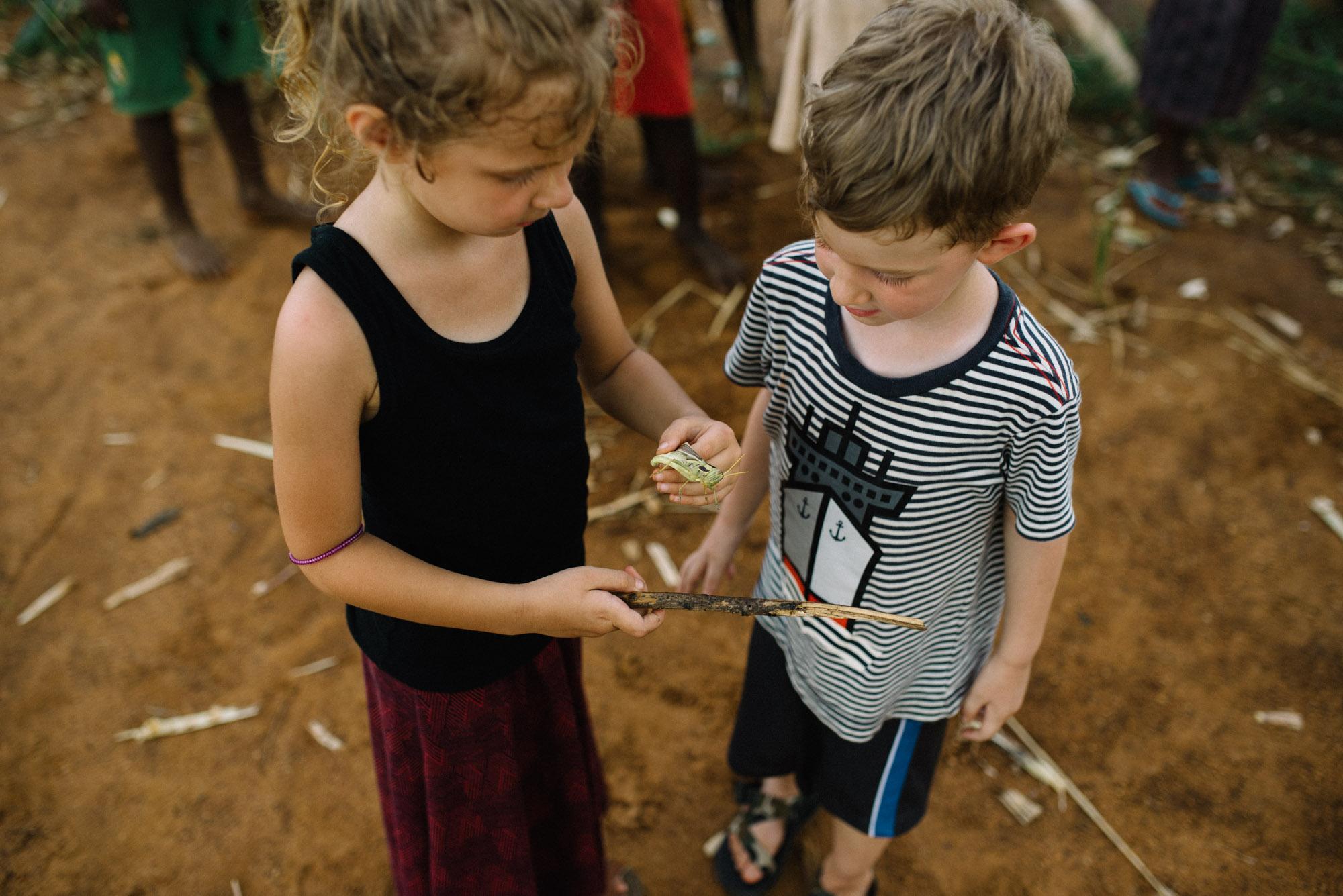 Addie and Ezra found a locust. :)