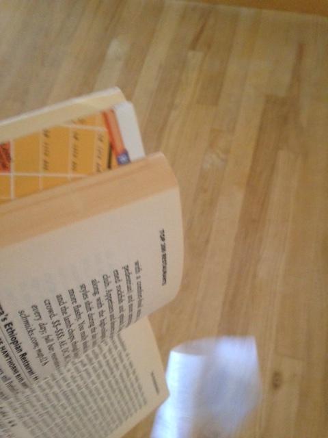 A receipt falls out of a shaken book.