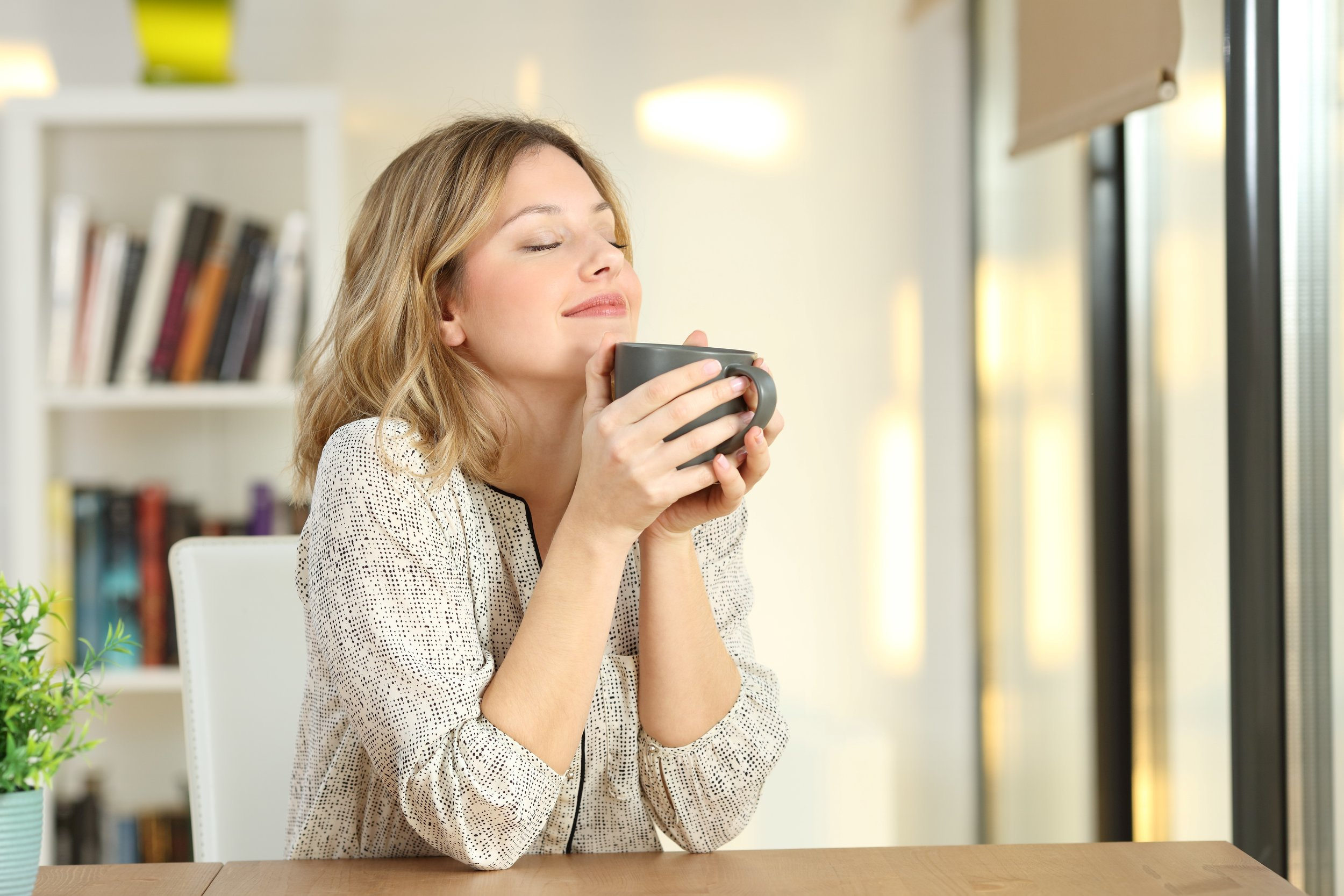 woman sipping coffee postcard.jpg