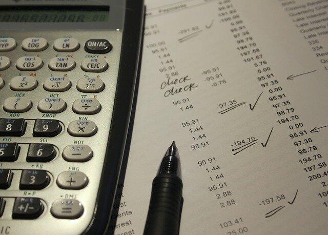 accounting-761599_640 bills Image by Lucia Grzeskiewicz from Pixabay calculator.jpg