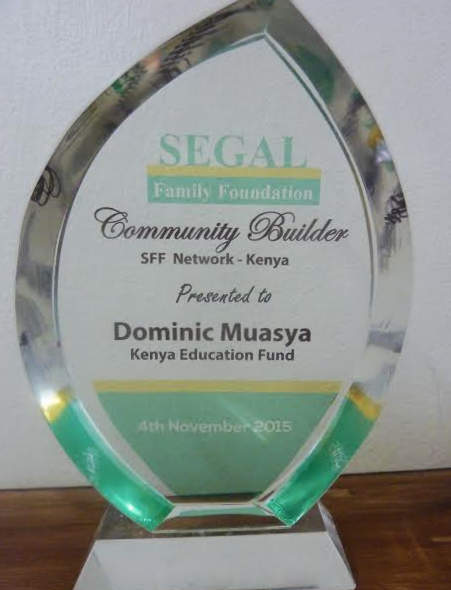 """In 2015, KEF's Dominic Muasya was presented with a """"Community Builder"""" award from our partner, Segal Family Foundation. Dominic has been instrumental in facilitating relationships btw Segal grantee organizations in Kenya."""