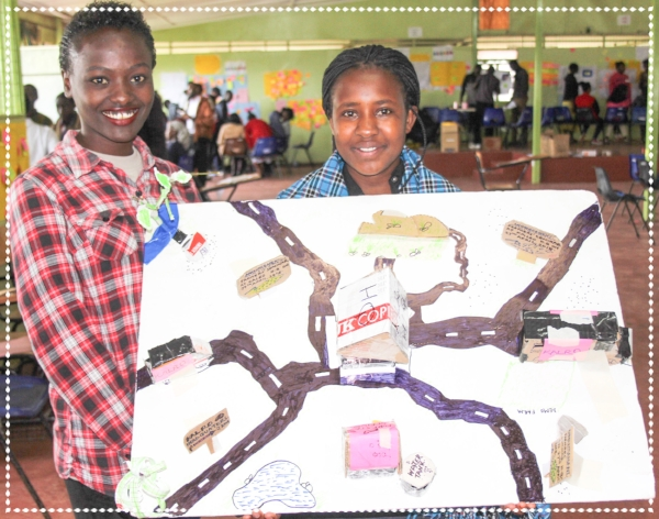 (Faith and Winnie displaying their prototype in an Entrepreneurship session)