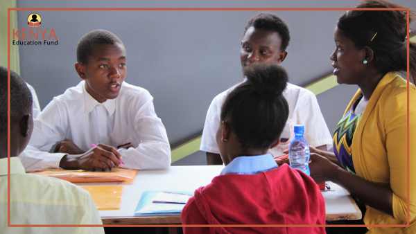 (Rosebella from Prudential Kenya engaging with students during a speed coaching session)