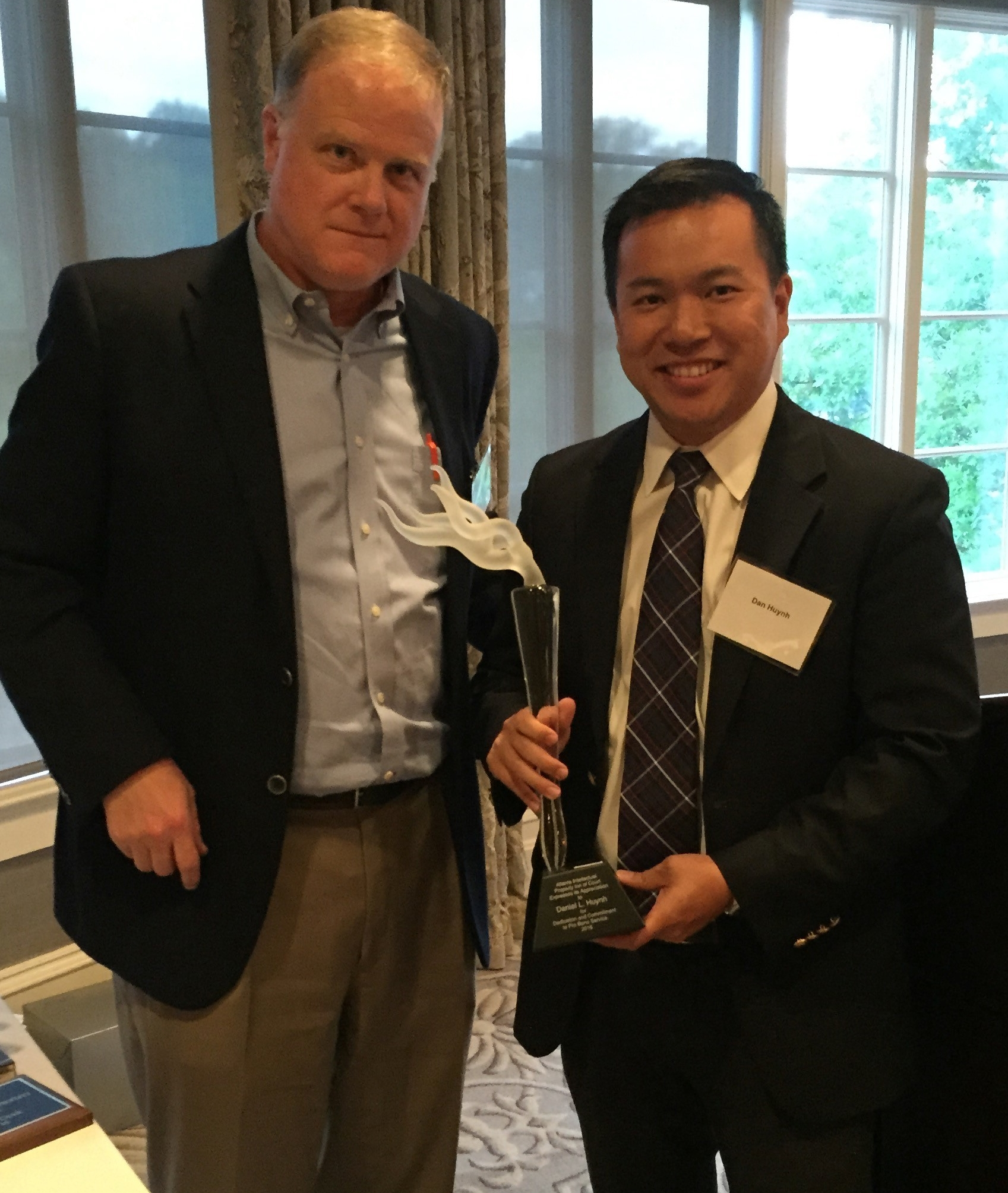 2016 Recipient Daniel Huynh (right) with Pro Bono Award Committee Coordinator, Frank Landgraff (left)