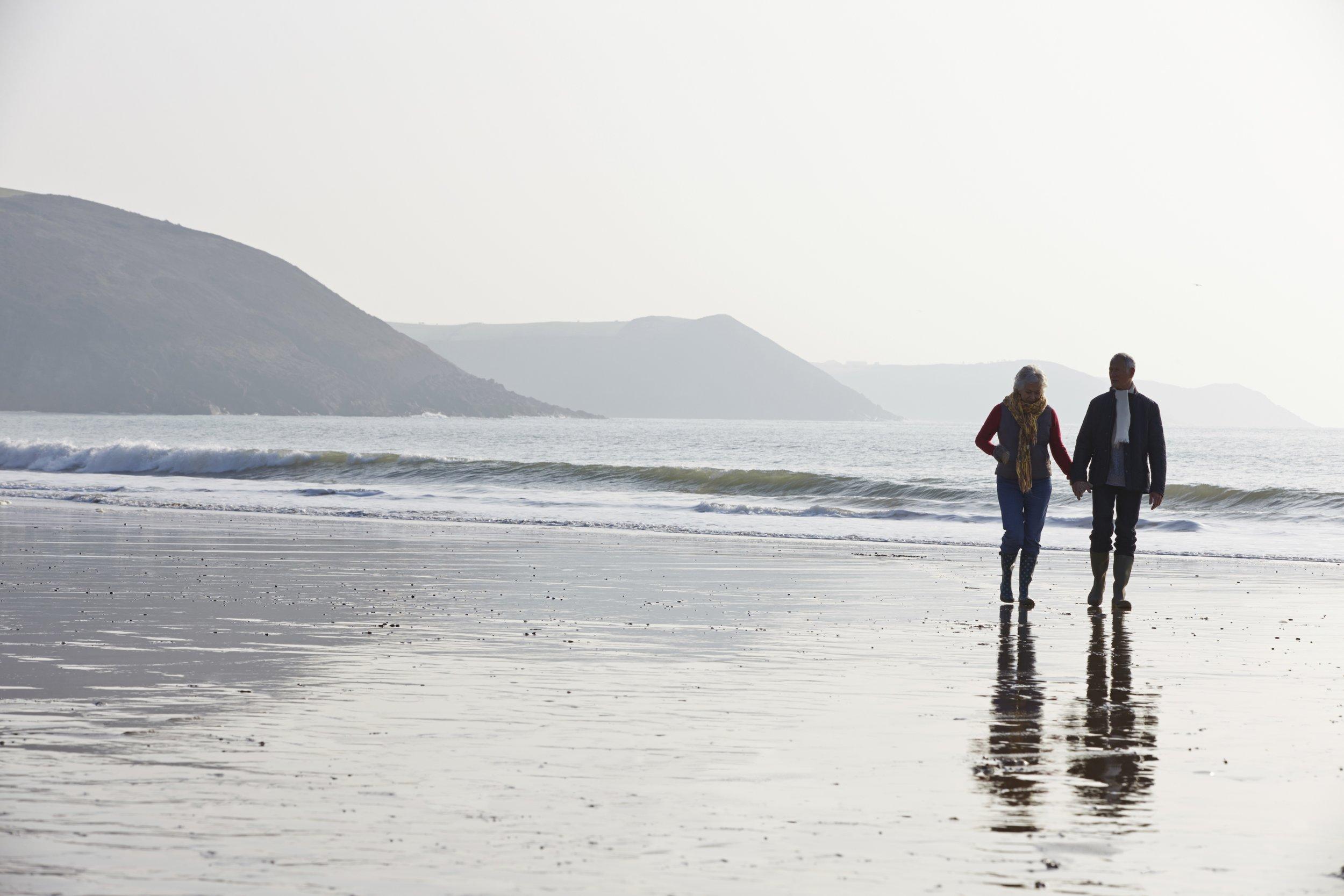 Senior Couple Walking on Beach.jpg